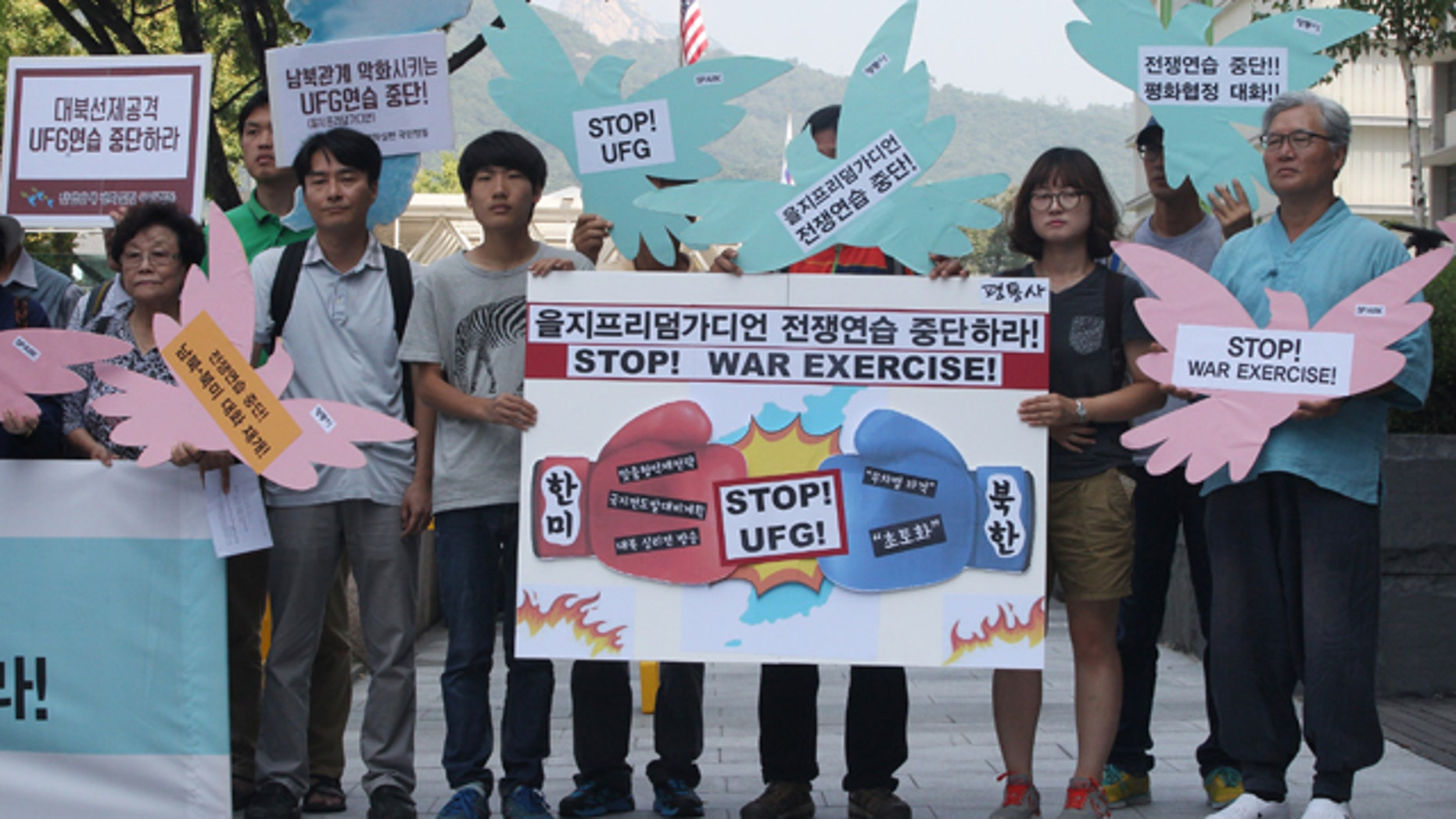 Aug. 17, 2015: South Korean protesters stage a rally demanding to stop the joint military exercises, Ulchi Freedom Guardian or UFG, between the U.S. and South Korea near the U.S. Embassy in Seoul, South Korea, The banner at center, reads 'Stop Ulchi Freedom Guardian exercise.' (AP Photo/Ahn Young-joon)