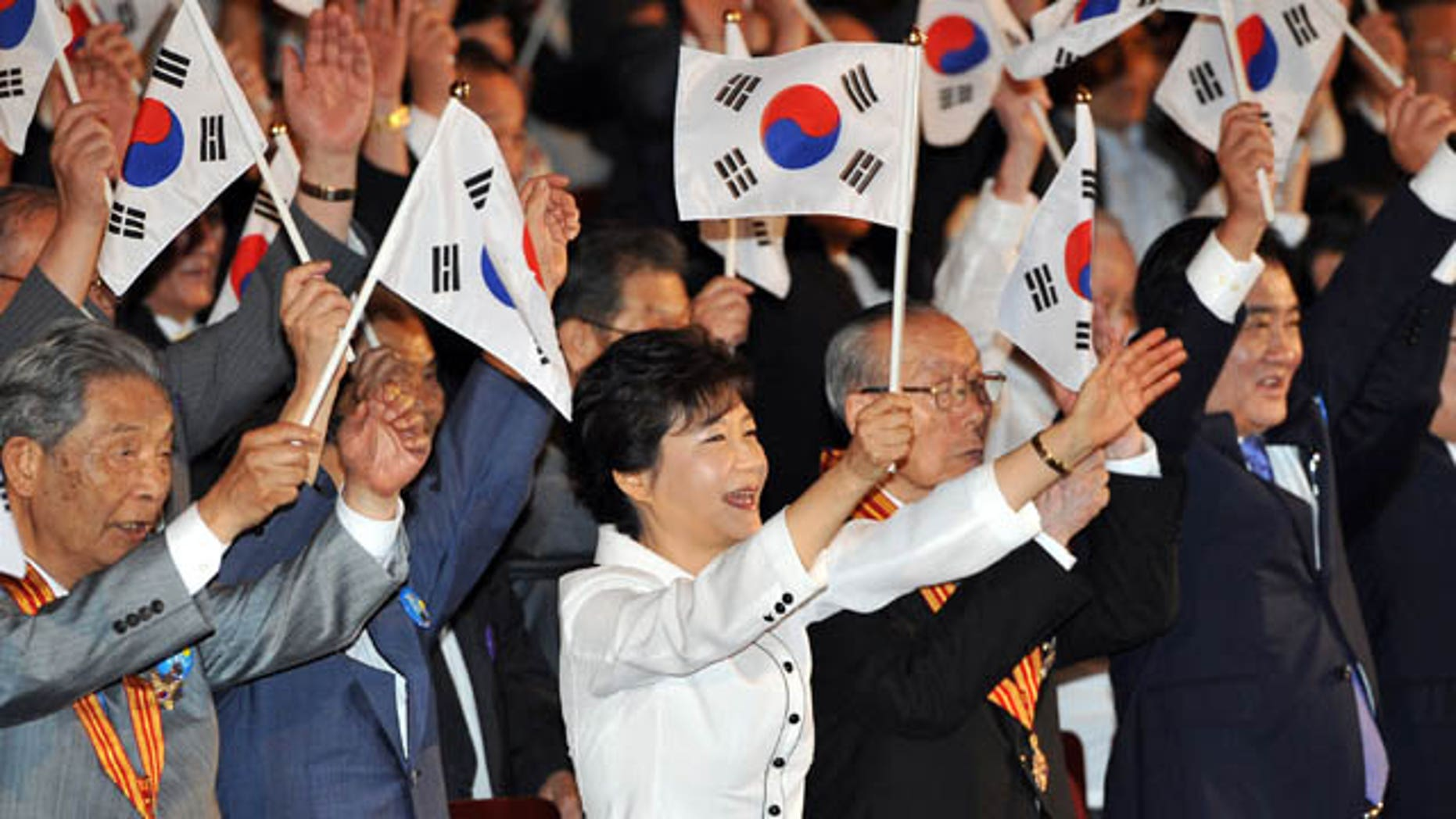 August 15, 2013: South Korean President Park Geun-hye gives three cheers for the country during a ceremony marking the 68th anniversary of liberation from Japanese colonial rule in Seoul. (AP Photo/Jung Yeon-je, Pool)