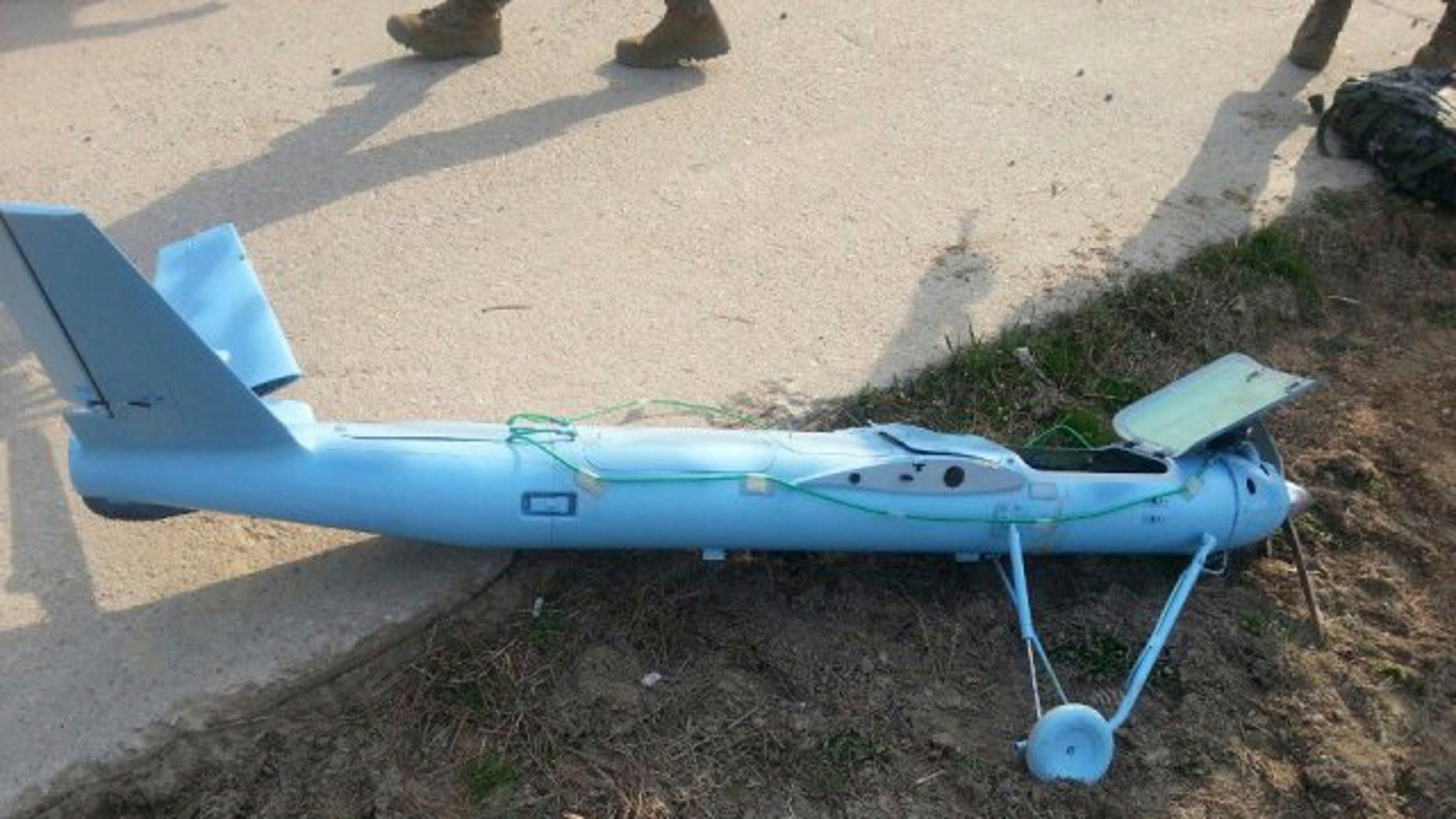 March 31, 2014: In this photo released by the South Korea Defense Ministry, an unmanned drone lies on the ground damaged on Baengnyeong Island, South Korea, near the West Sea border with North Korea when the two Koreas fired hundreds of artillery shells into each other's waters. South Korea suspects that the drone that crashed on the frontline South Korean island was flown by rival North Korea, an official said Wednesday. (AP Photo/South Korea Defense Ministry)