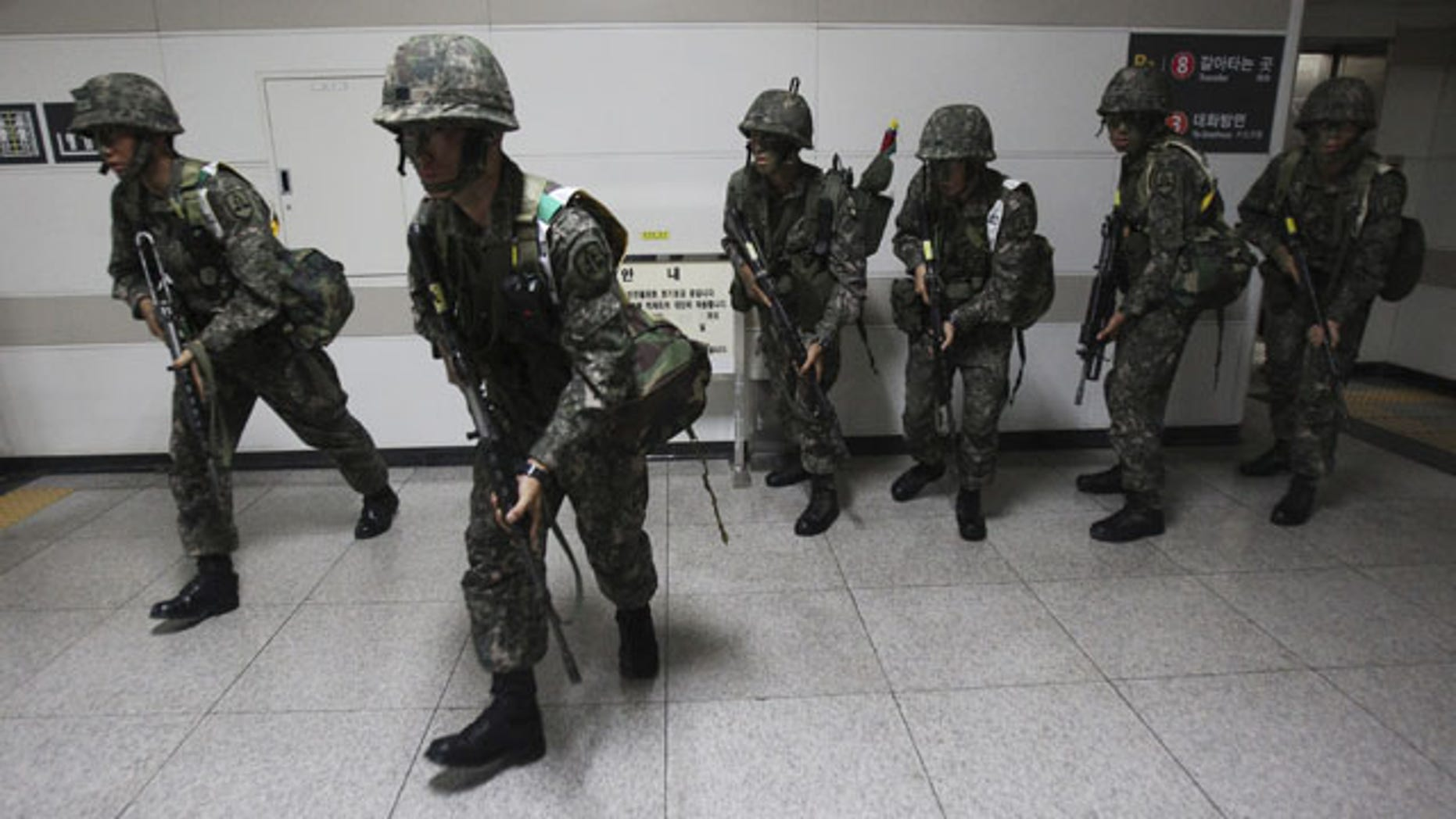 """August 19, 2013: South Korean army soldiers take part in South Korea-U.S. joint military exercise, """"Ulchi Focus Lens,"""" at a subway station in Seoul. (AP Photo)"""