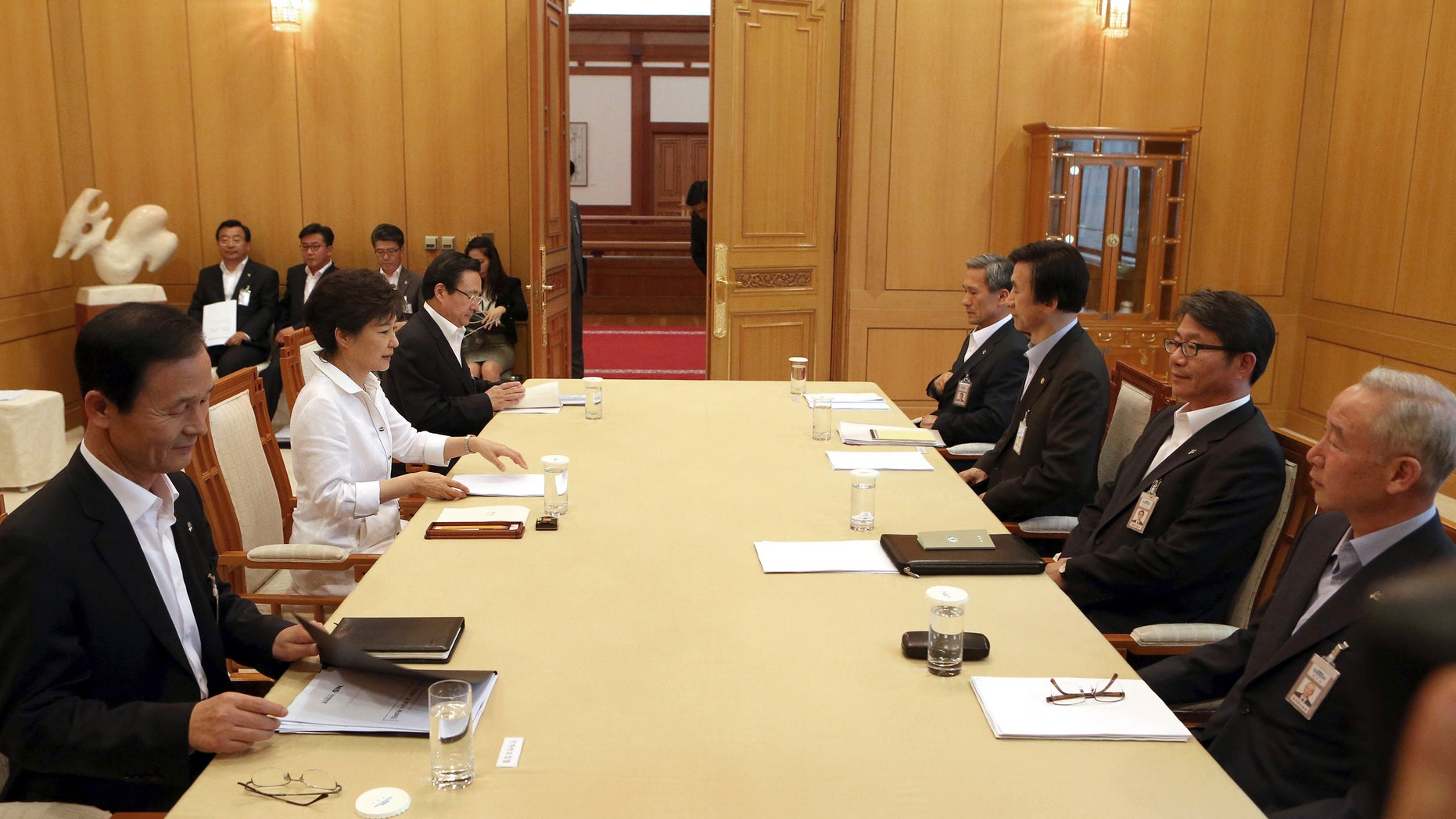 June 10, 2013 - South Korean President Park Geun-hye, 2nd  from left, presides over a security meeting to discuss the upcoming South and North Korea talks at the presidential house in Seoul, South Korea.