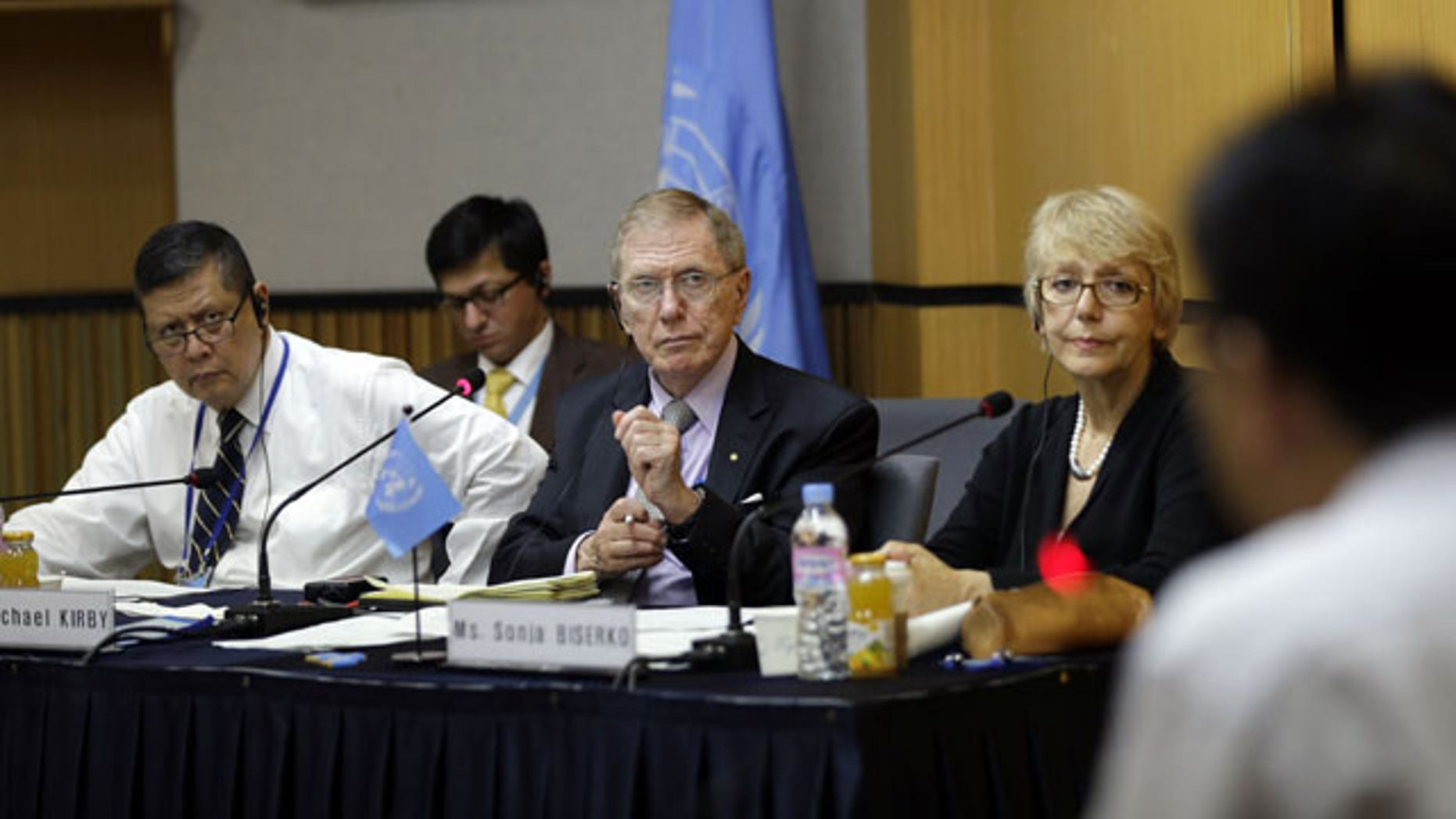 August 21, 2013: Michael Donald Kirby, center, the chairman of the U.N. commission of Inquiry on human rights in North Korea, listens to Ahn Myung-chul, right, who worked as a guard and driver at several political prisoner camps in the 1990s before defecting to south, during the U.N. hearing in Seoul, South Korea.