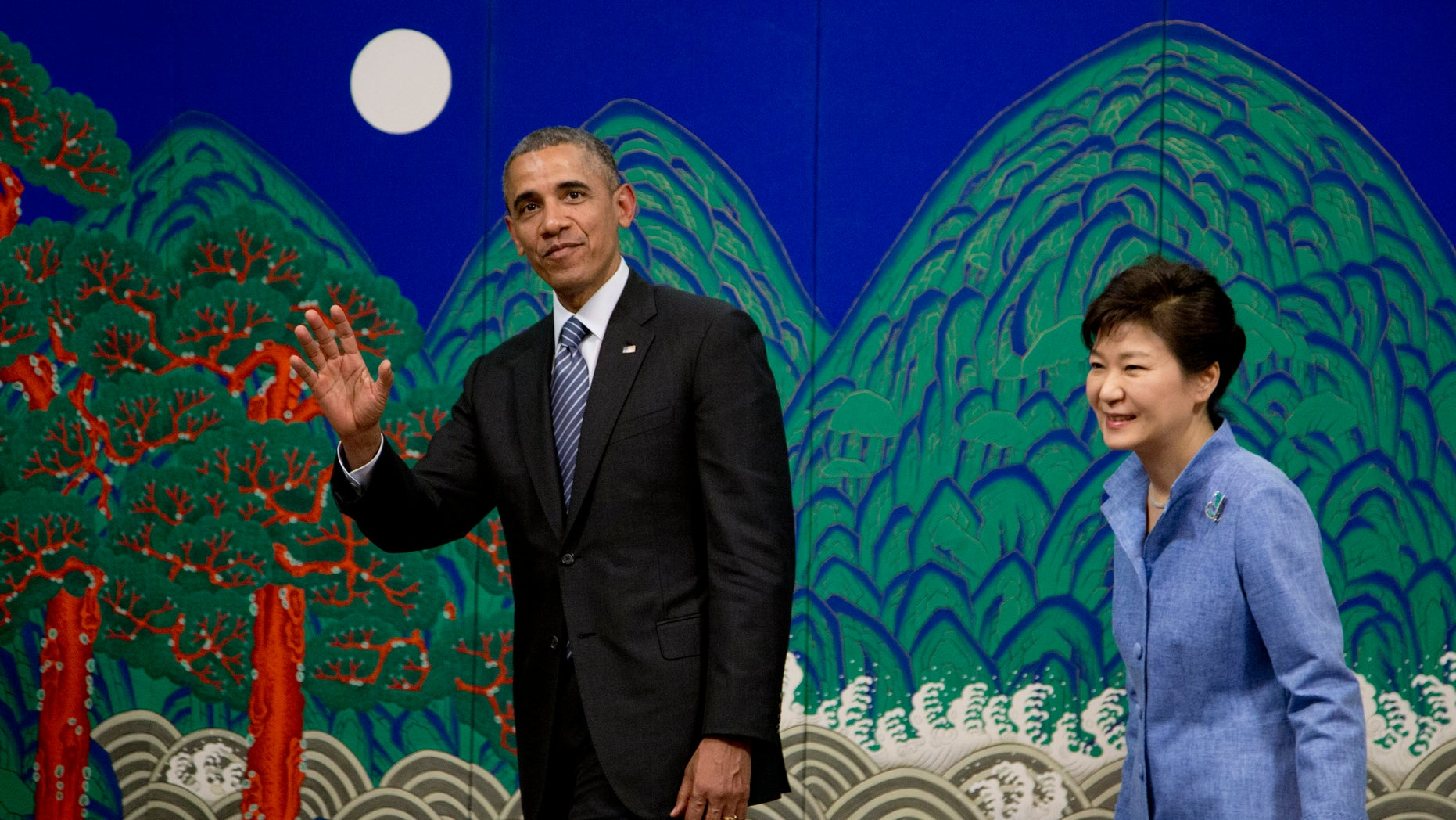 April 25, 2014 - President Obama waves to media as he leaves a ceremony with South Korean President Park Geun-hye at the Blue House, in Seoul, South Korea.