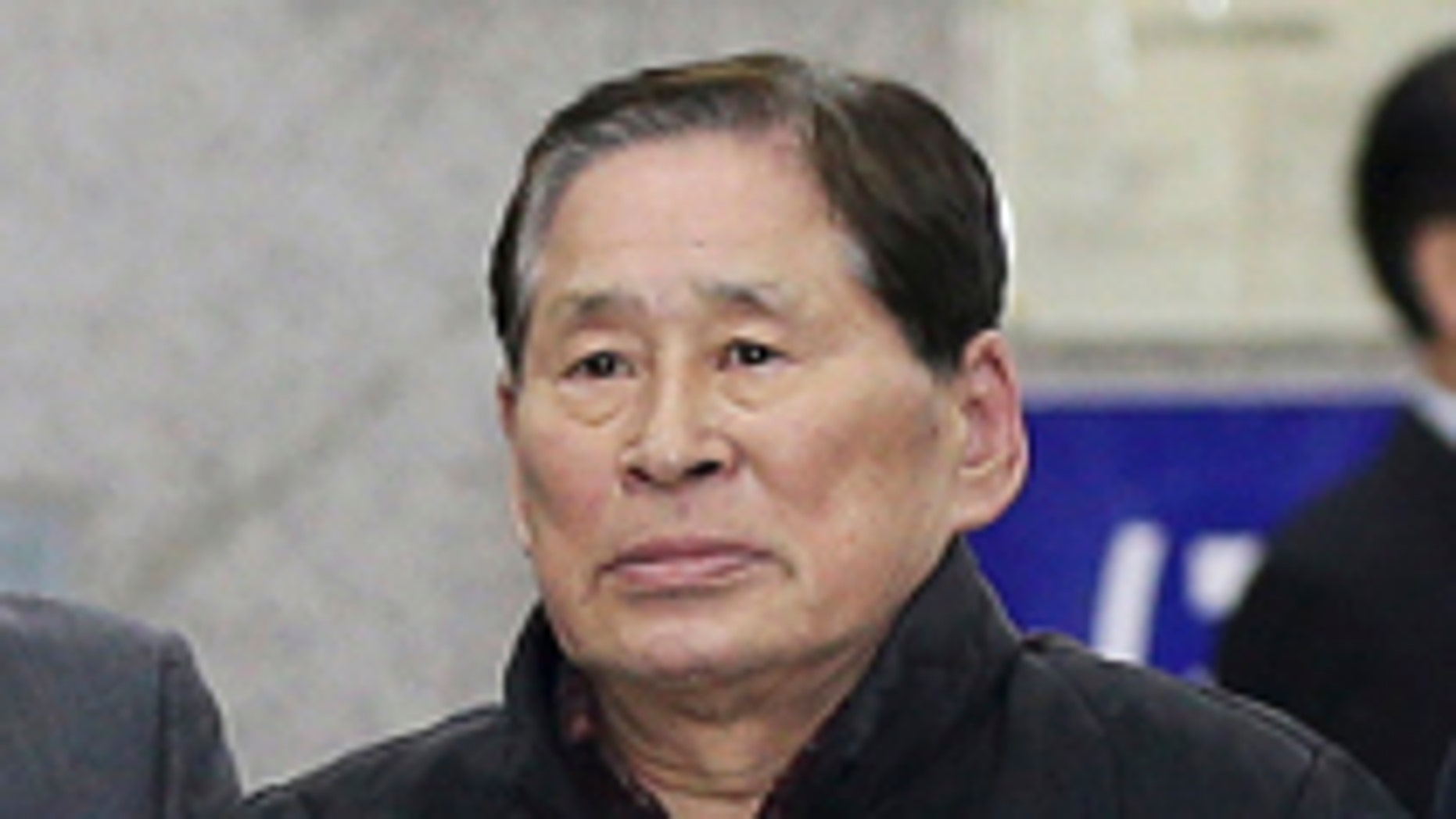 April 17, 2014: Kim Han-sik, president of Chonghaejin, is escorted by helpers to hold a press conference at Incheon Port International Passenger Terminal in Incheon, South Korea. South Korean prosecutors on Thursday detained Kim, the head of the company that owns the ferry that sank last month, over an allegation of cargo overloading.(AP Photo/Yonhap)  KOREA OUT