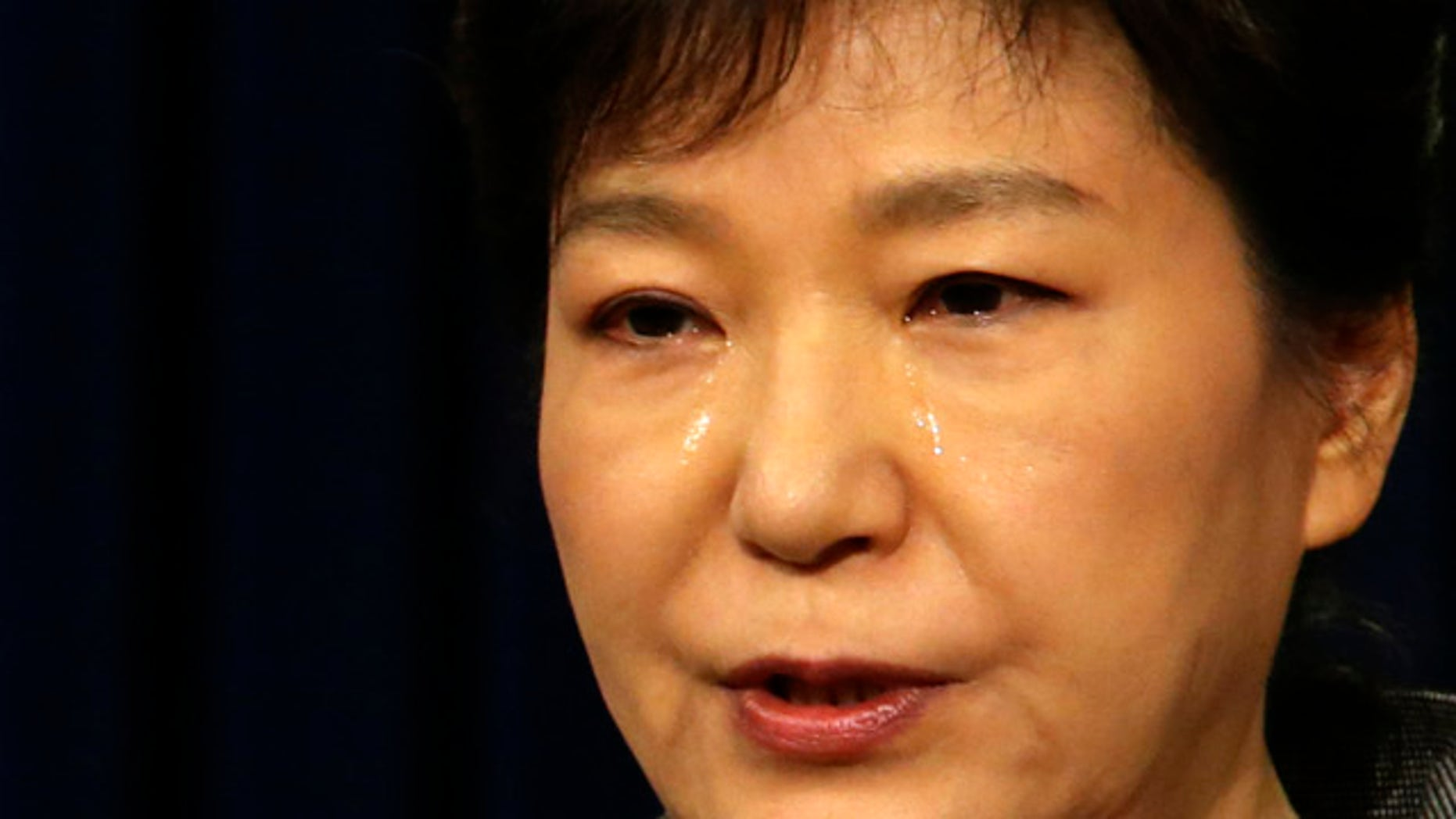 May 19, 2014: South Korean President Park Geun-hye weeps while delivering a speech to the nation about the sunken ferry Sewol at the presidential Blue House in Seoul. (AP Photo/Yonhap, Do Kwang-hwan)