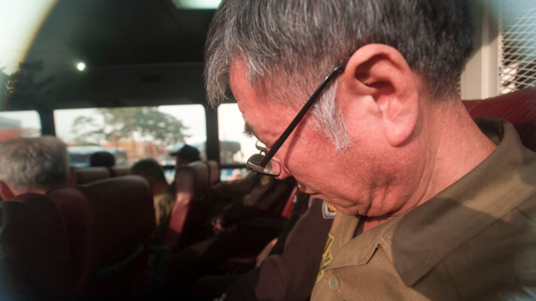 November 11, 2014: Lee Joon-seok, the captain of the sunken South Korean ferry Sewol arrives for verdict and sentence session at Gwangju District Court in Gwangju, South Korea. (AP Photo/Yonhap, Hyung Min-woo)