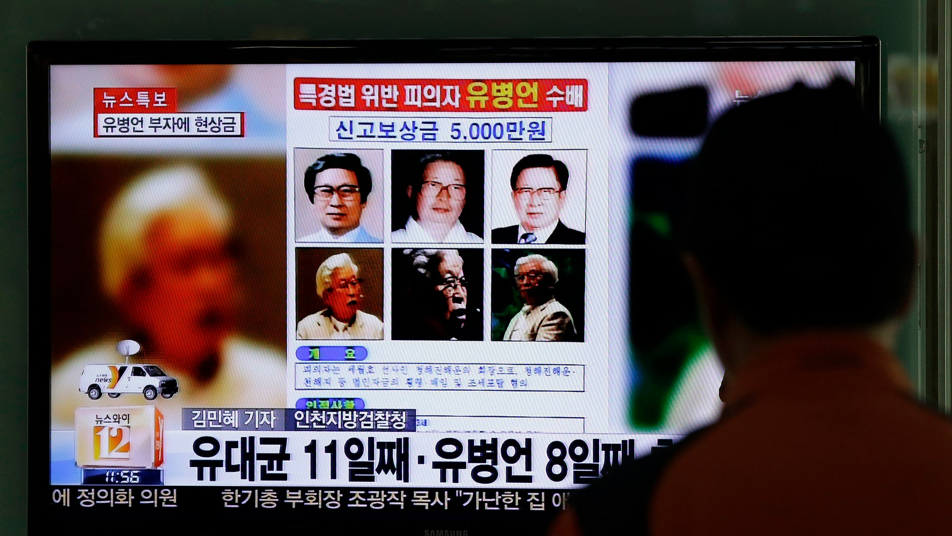 May 23, 2014 - A TV news program shows the reward poster of Yoo Byung-eun at the Seoul Train Station in Seoul, South Korea. South Korea is offering a big bounty to find the mysterious billionaire thought to be the owner a ferry that sank last month, leaving more than 300 people dead or missing.