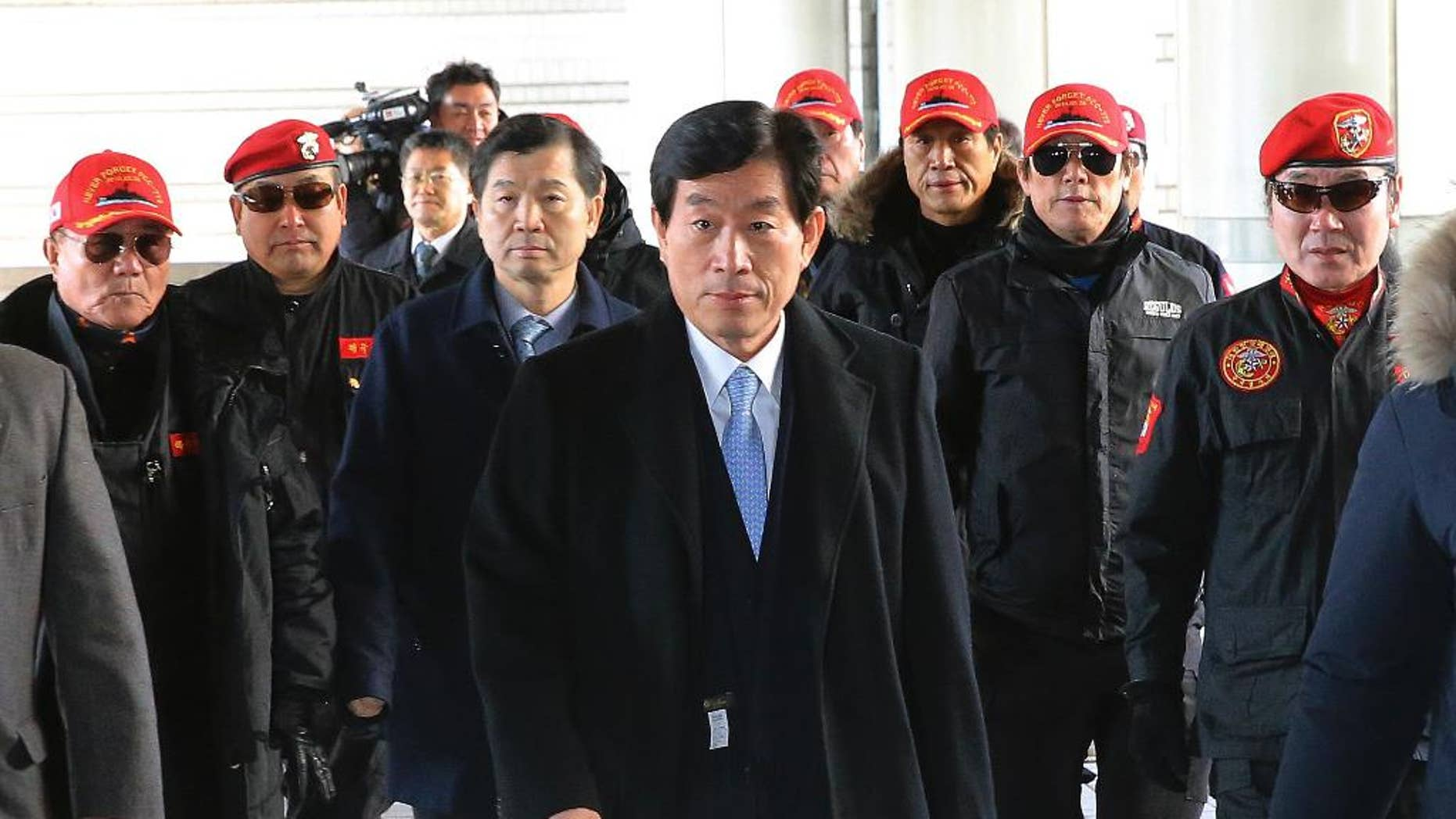 Former National Intelligence Service director Won Sei-hoon, center, arrives at the Seoul High Court in Seoul, South Korea, Monday, Feb. 9, 2015. Won headed to prison after being found guilty of ordering an illicit online campaign to support then-ruling party candidate and current President Park Geun-hye ahead of the 2012 presidential election. (AP Photo/Yonhap)  KOREA OUT