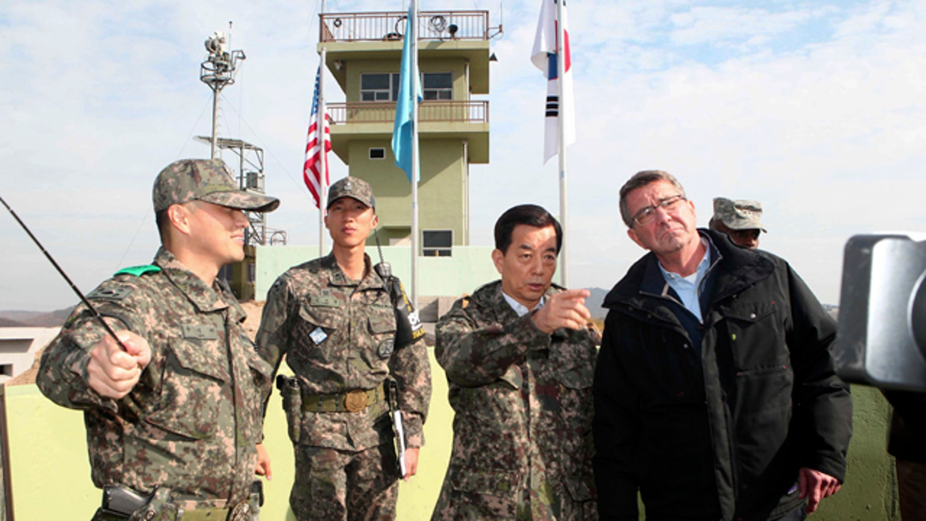 Nov. 1, 2015: U.S. Defense Secretary Ash Carter, right, and South Korean Defense Minister Han Min Koo, second from right, look towards North Korea at an observation post near the border village of Panmunjom, which has separated the two Koreas since the Korean War. (Korea Pool Photo via AP)