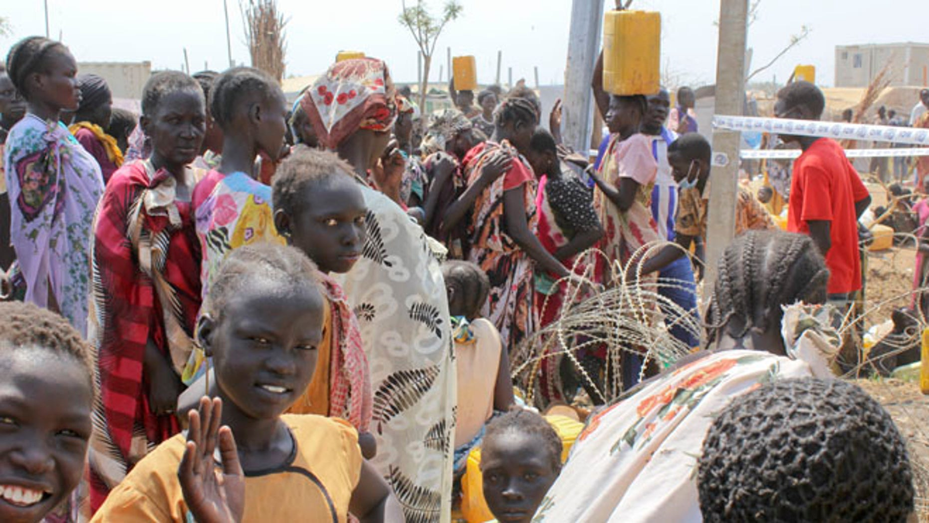 Jan. 28, 2014: In this photo, displaced South Sudanese women queue for water at the United Nations base where they have sought shelter in Malakal, South Sudan.