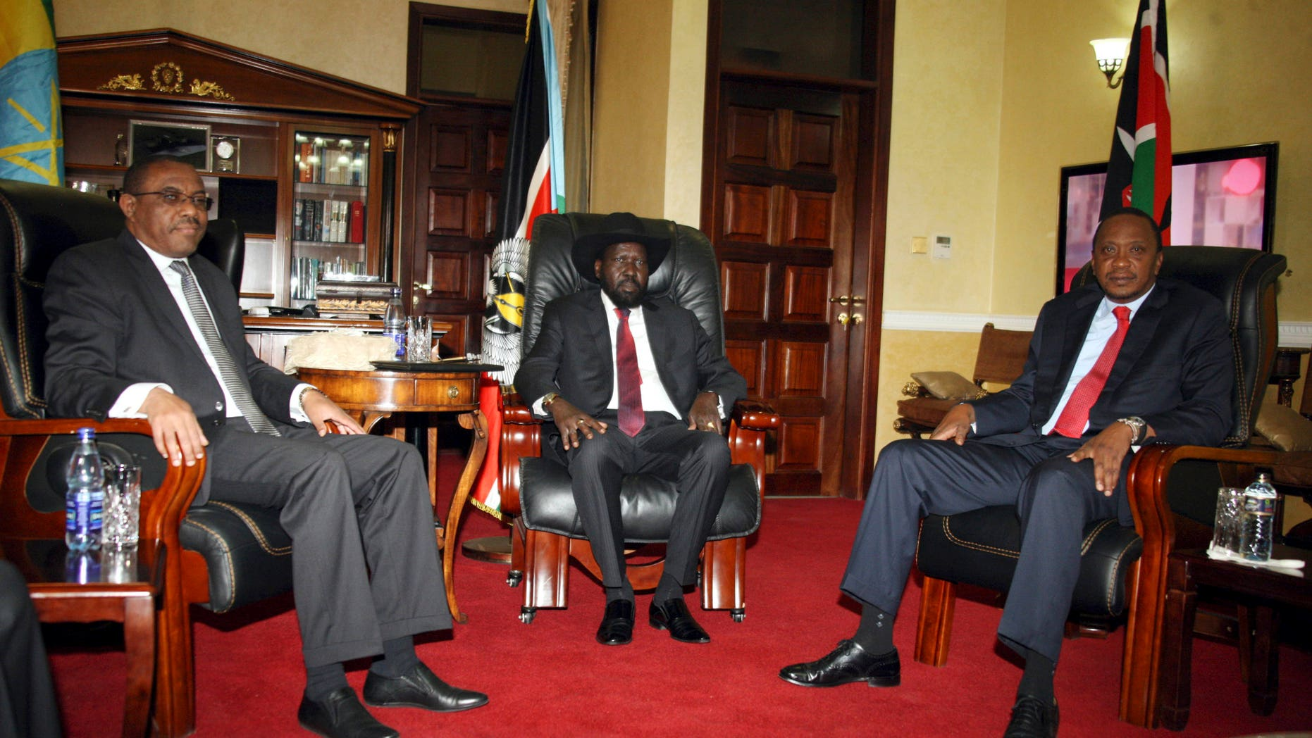 Dec. 26, 2013 - Ethiopian Prime Minister Hailemariam Desalegn, left, South Sudanese President Salva Kiir, center, and  Kenyan President Uhuru Kenyatta pose for photos before their meeting at State House in Juba, South Sudan. The leaders of Kenya and Ethiopia arrived Thursday to try to mediate between the country's president and the political rivals he accuses of attempting a coup that the government insists sparked violence threatening to destroy the world's newest country.