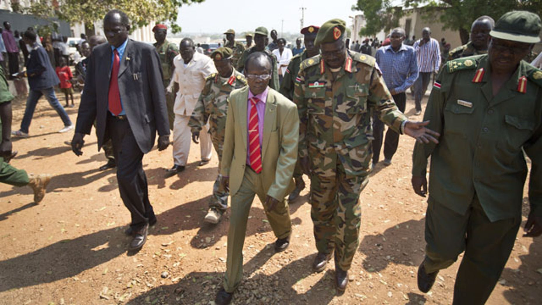 December 28, 2013: South Sudan's current Vice-President James Wani Igga, centre left, arrives to visit wounded patients at the Juba Military Hospital in Juba, South Sudan. (AP Photo)