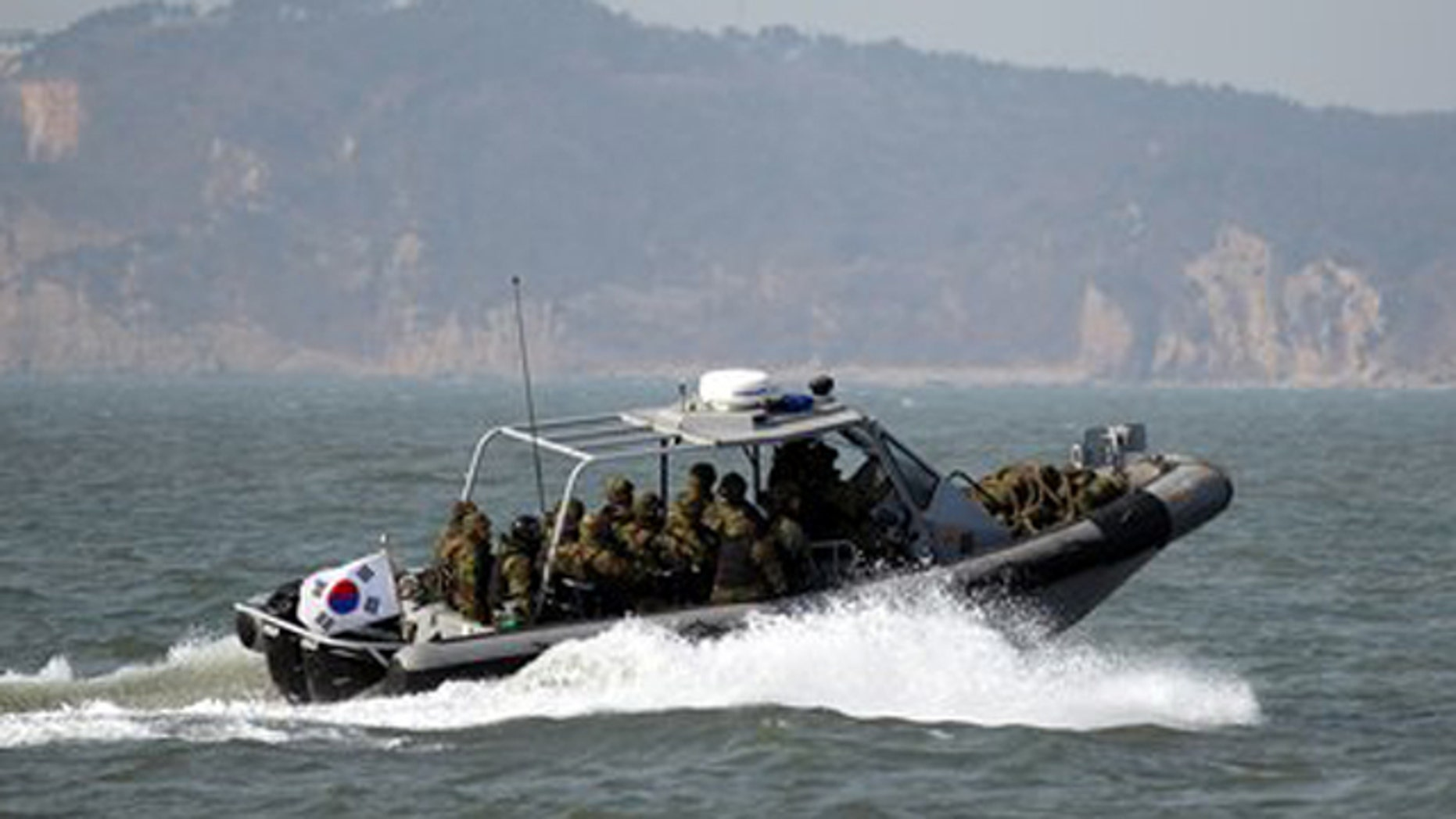 Feb. 20, 2012: South Korean navy sailors in a speed boat patrol around South Korea's western Yeonpyong Island after finishing their exercise, near the disputed sea border with North Korea.