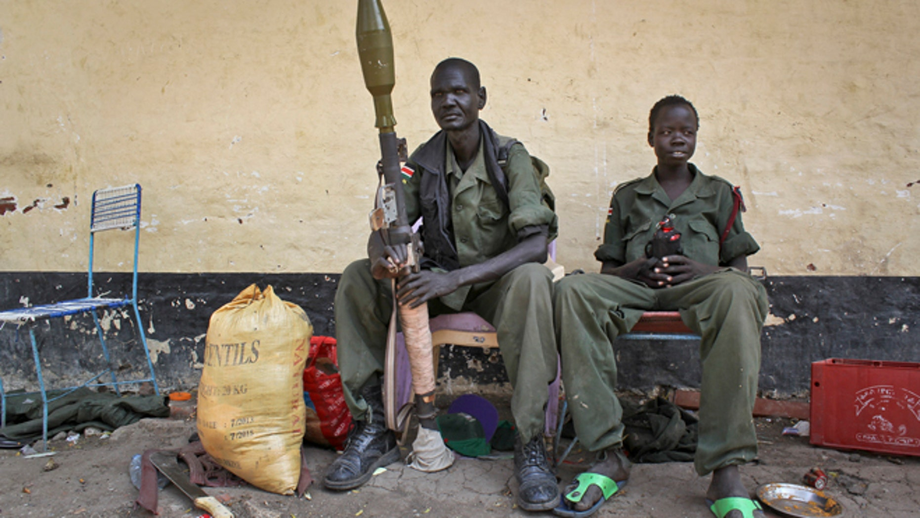 Feb. 26, 2014: Rebels sit in the now-emptied hospital in Malakal, South Sudan.