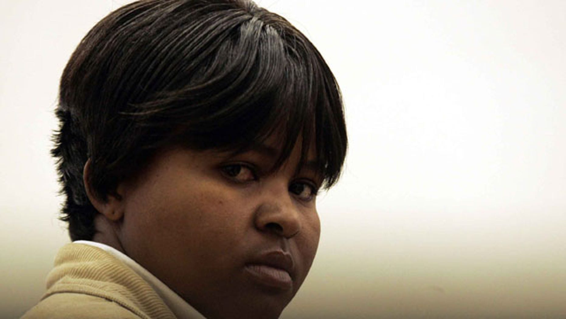 In this July 29, 2008 file photo, South African Tiny Virginia Makopo stands in the dock, at the start of a trial at the Sebokeng Magistrate Court, south of Johannesburg, South Africa.