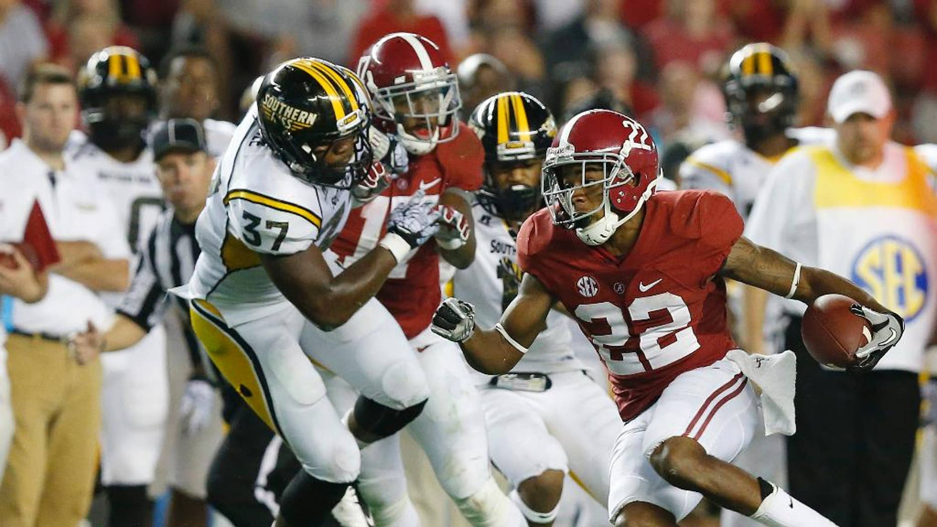 Alabama wide receiver Christion Jones (22) runs the ball during the second half of an NCAA college football game against Southern Mississippi on Saturday, Sept. 13, 2014, in Tuscaloosa, Ala. (AP Photo/Brynn Anderson)
