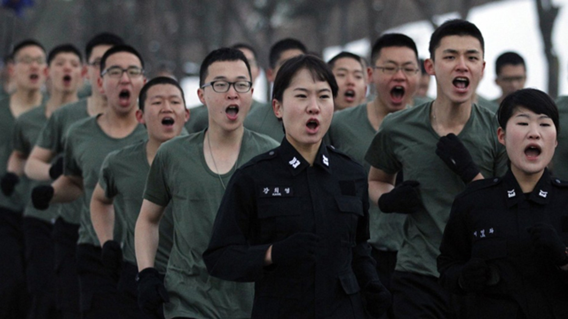South Korean soldiers of the capital defense command run at a training at barracks of the command in Seoul