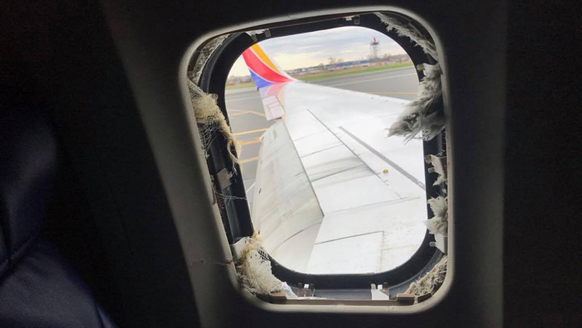 "During a terrifying Southwest flight, one woman was ""partially sucked out"" of the airplane's window after a piece of shrapnel reportedly broke through."