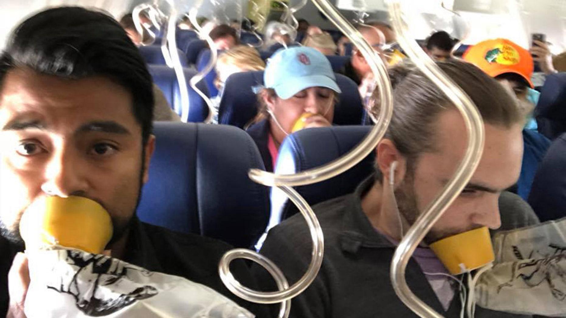 Passenger Marty Martinez captured the moment when oxygen masks were deployed on the flight.