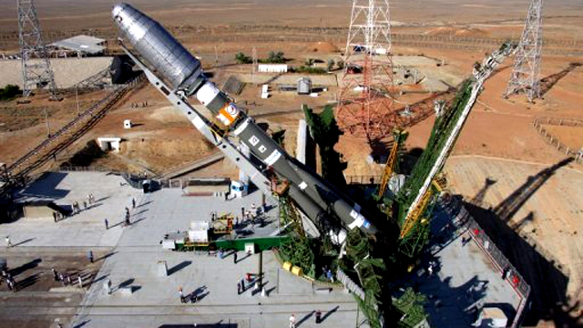 """July, 2011: A Soyuz rocket is erected on the launch pad of the Baikonur cosmodrome. Moscow declared it was now """"the era of the Soyuz"""" after the US shuttle's last flight left the Russian system as the sole means for delivering astronauts to the International Space Station."""