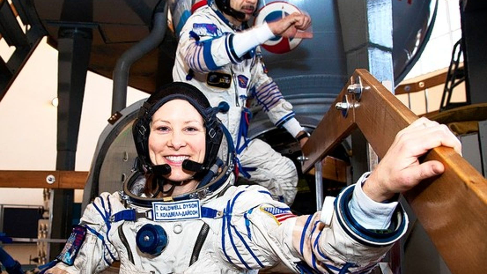 U.S. astronaut Tracy Caldwell Dyson and Russia's Mikhail Kornienko in March at a space center near Moscow.