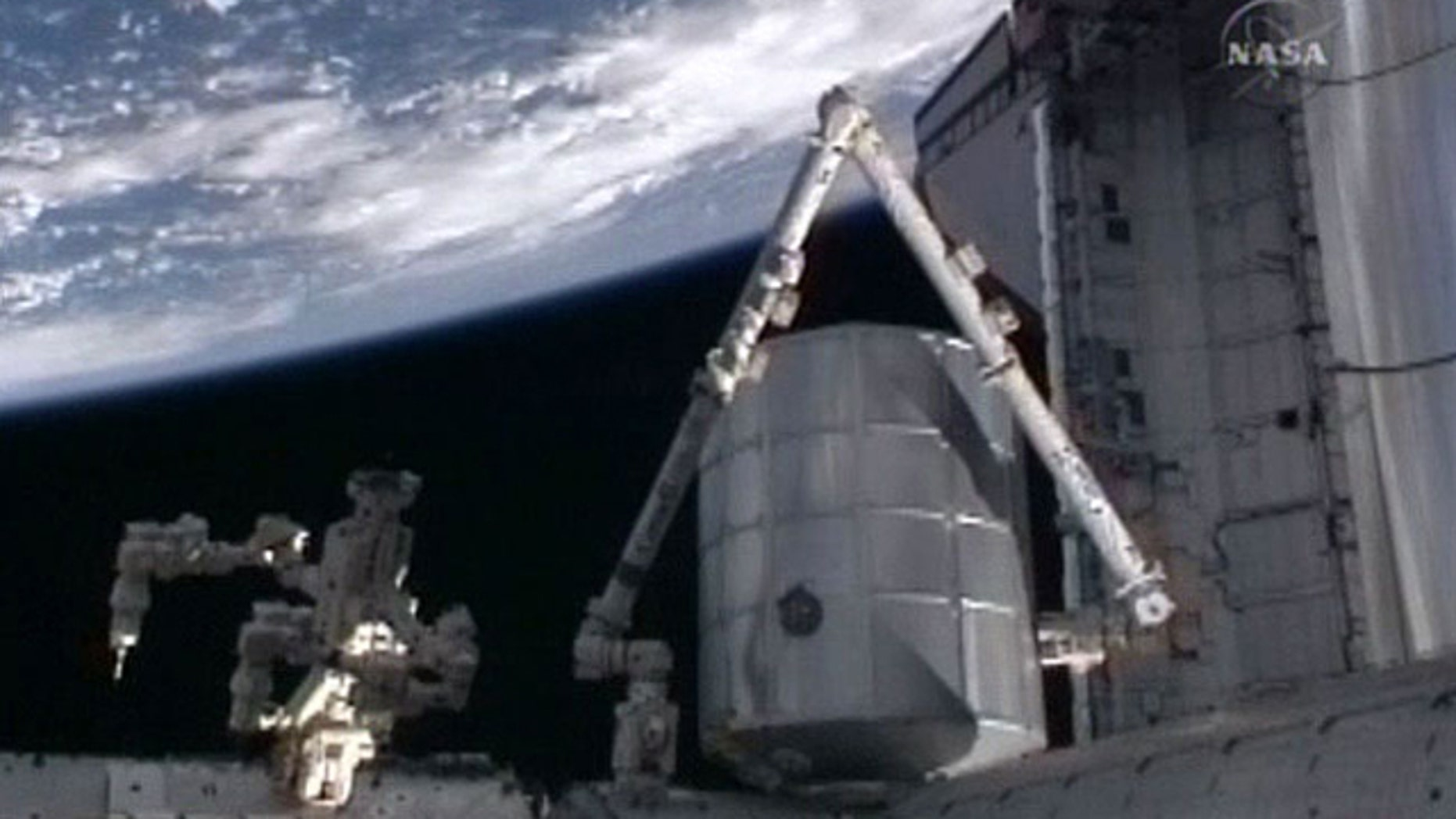 The cargo pod Leonardo, a multi-purpose logistics module for the International Space Station, is attached to the Earth-facing berth of the outpost's Harmony node on April 8, 2010 after being moved from shuttle Discovery's payload bay during the STS-131 mission.