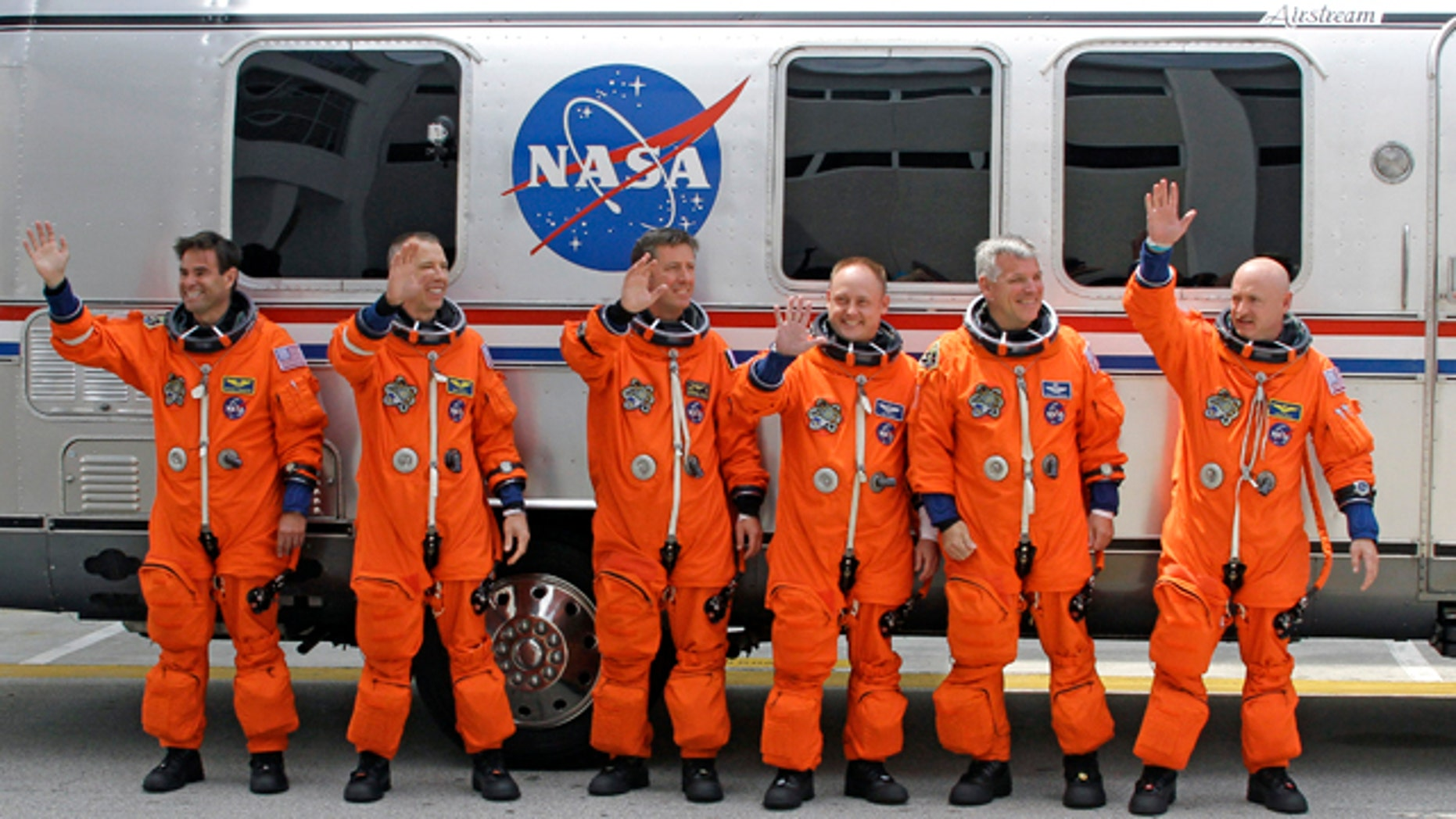 April 29, 2011: The crew of space shuttle Endeavour, from left, Canadian born U.S. astronaut Greg Chamitoff, mission specialist Drew Feustel, European Space Agency astronaut Roberto Vittori, of Italy, mission specialist Mike Fincke, British born U.S. astronaut, pilot Greg Johnson and commander Mark Kelly.