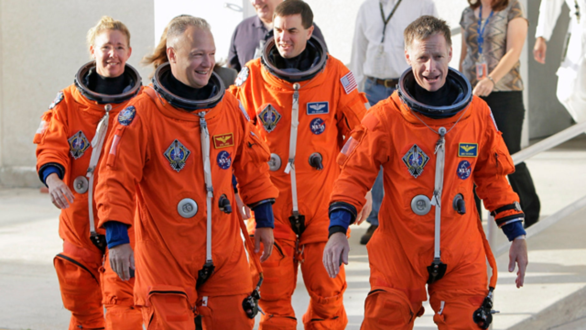 June 23: The crew of space shuttle Atlantis, from left, mission specialist Sandy Magnus, pilot Doug Hurley, mission specialist Rex Walhiem and commander Chris Ferguson, leave the Operations and Checkout Building on their way to board the shuttle for their final day of training during the Terminal Countdown Demonstration Test at the Kennedy Space Center in Cape Canaveral, FL.