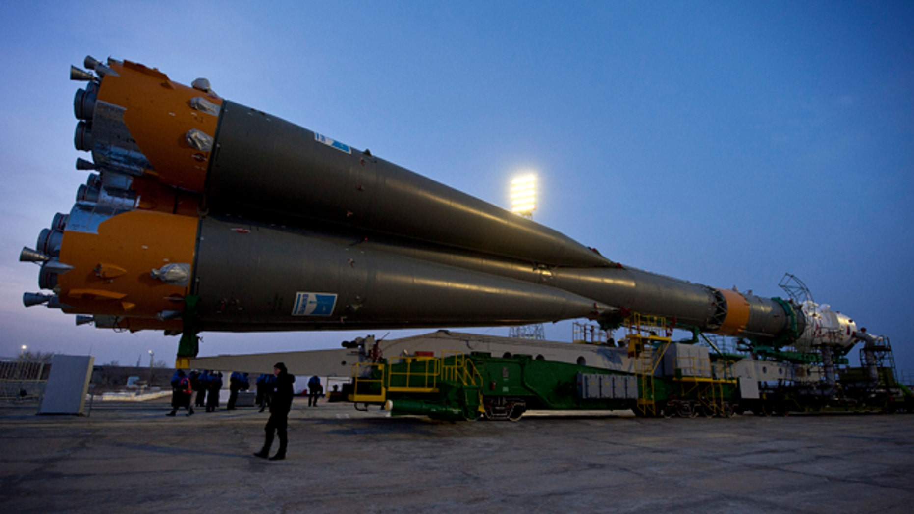 This image provided by NASA shows the Soyuz TMA-20 spacecraft as it arrives at the launch pad Monday, Dec. 13, 2010 at the Baikonur Cosmodrome in Kazakhstan.  NASA astronaut Catherine Coleman, Russian cosmonaut Dmitry Kondratyev and Paolo Nespoli of the European Space Agency are set to launch in the Soyuz to the International Space Station on Wednesday, Dec. 15, 2010, at 2:09 p.m. EST.