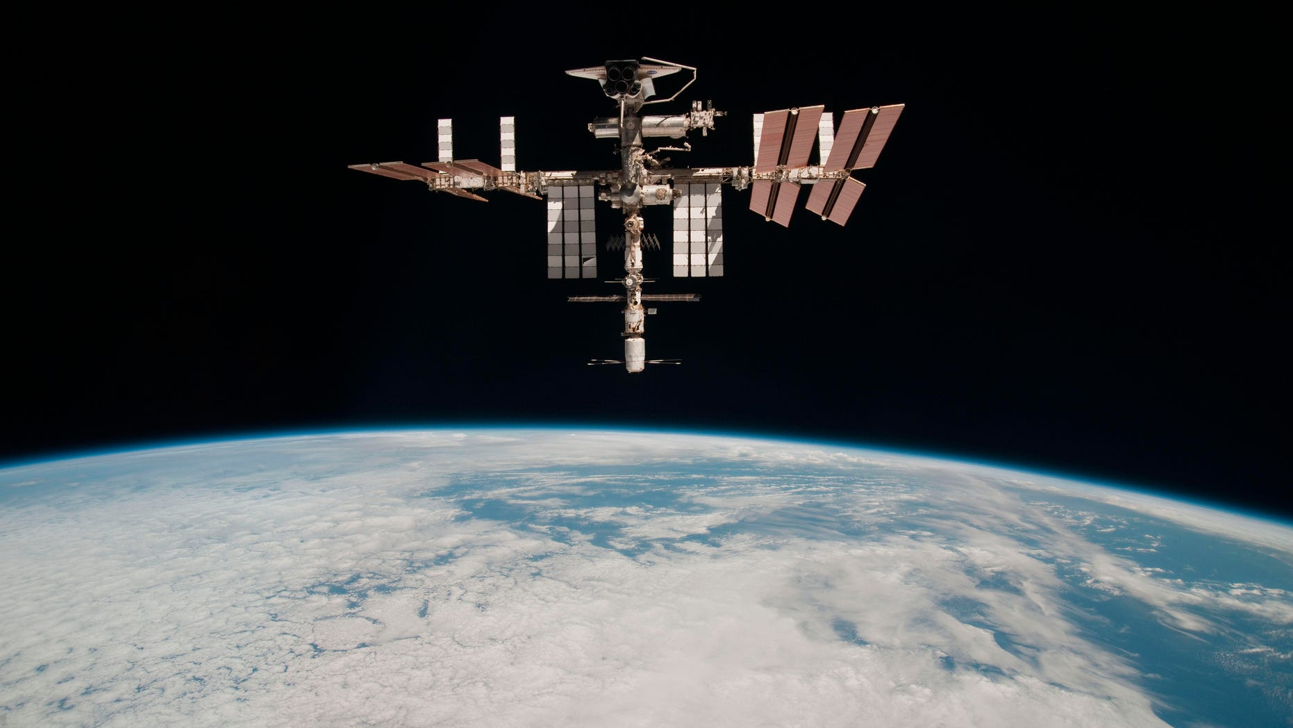 This May 23, 2011 photo released by NASA shows the International Space Station at an altitude of approximately 220 miles above the Earth, taken by Expedition 27 crew member Paolo Nespoli from the Soyuz TMA-20 following its undocking.
