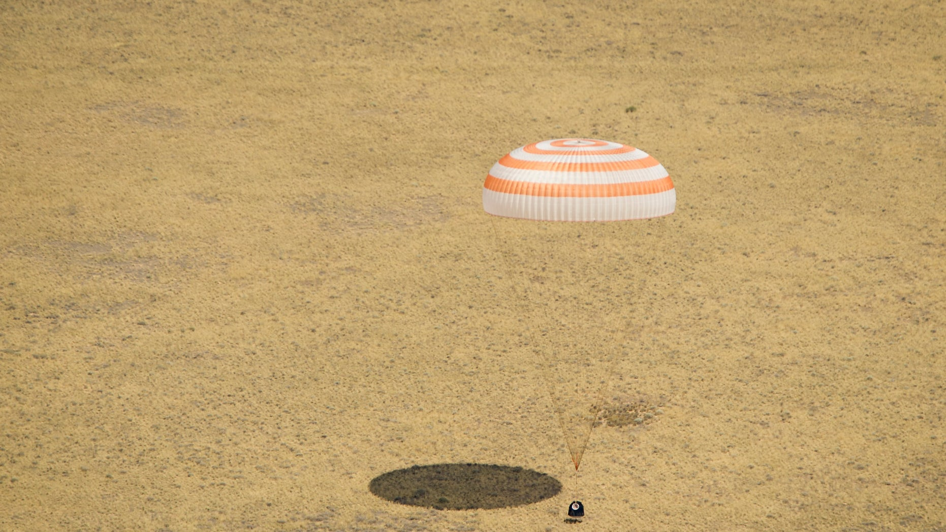 July 1, 2012: The Soyuz TMA-03M spacecraft is seen as it lands with Expedition 31 Commander Oleg Kononenko of Russia and Flight Engineers Don Pettit of NASA and Andre Kuipers of the European Space Agency in a remote area near the town of Zhezkazgan, Kazakhstan.