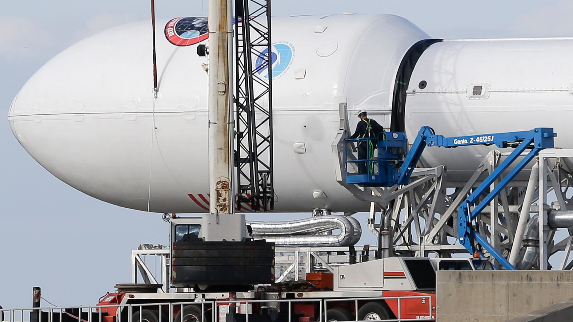 File photo - Maintenance is performed by workers on the Falcon 9 SpaceX rocket at launch complex 40 at the Cape Canaveral Air Force Station in Cape Canaveral, Fla., Monday, Feb. 9, 2015.