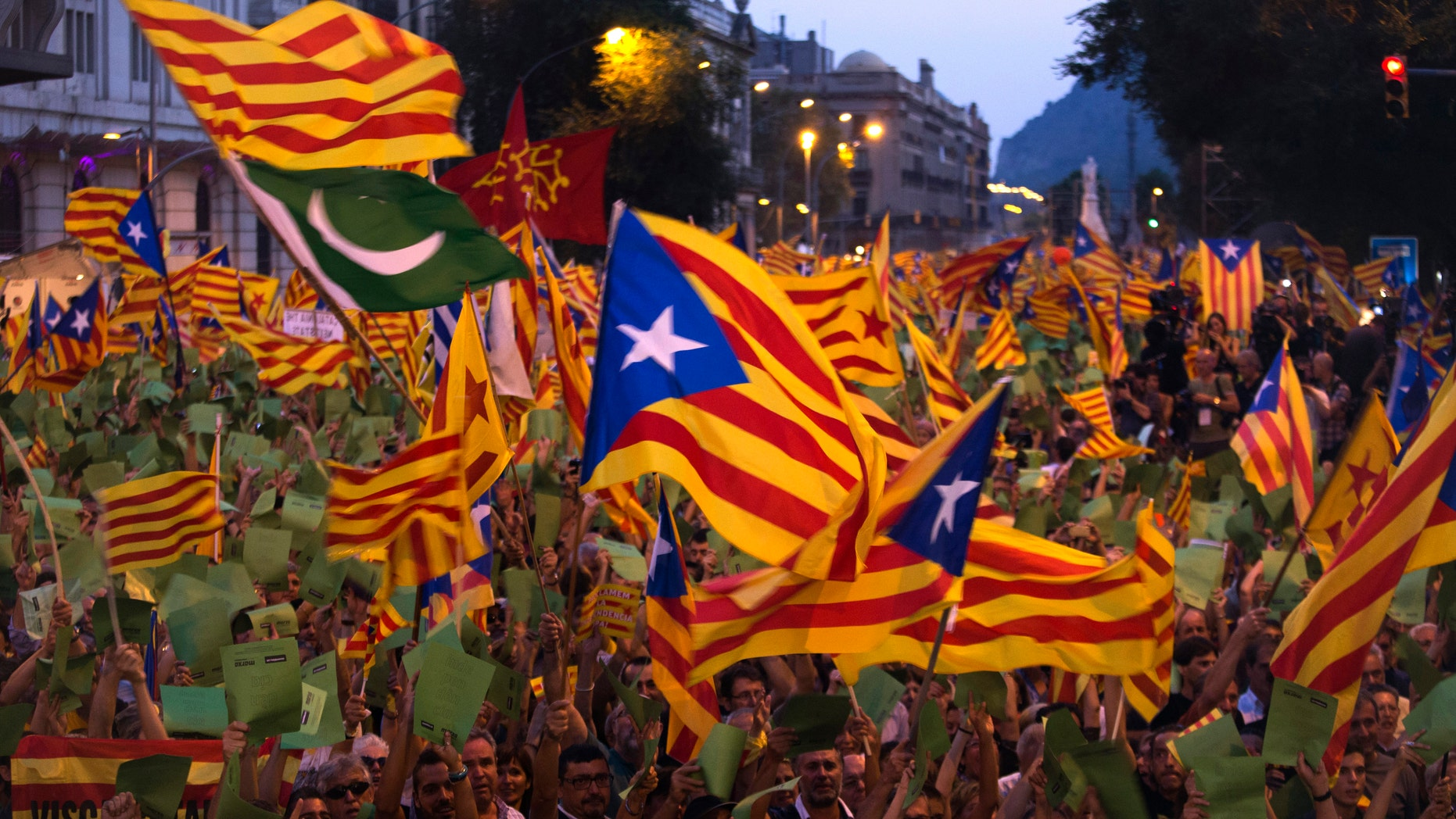 Demonstrators wave Catalan flags during a protest rally in Barcelona , Spain, in this Tuesday, Sept. 11, 2012 file photo. On Thursday, regional lawmakers voted to hold a referendum for Catalonia's seven million citizens to decide whether they want to break away from Spain. (AP Photo/Emilio Morenatti, File)