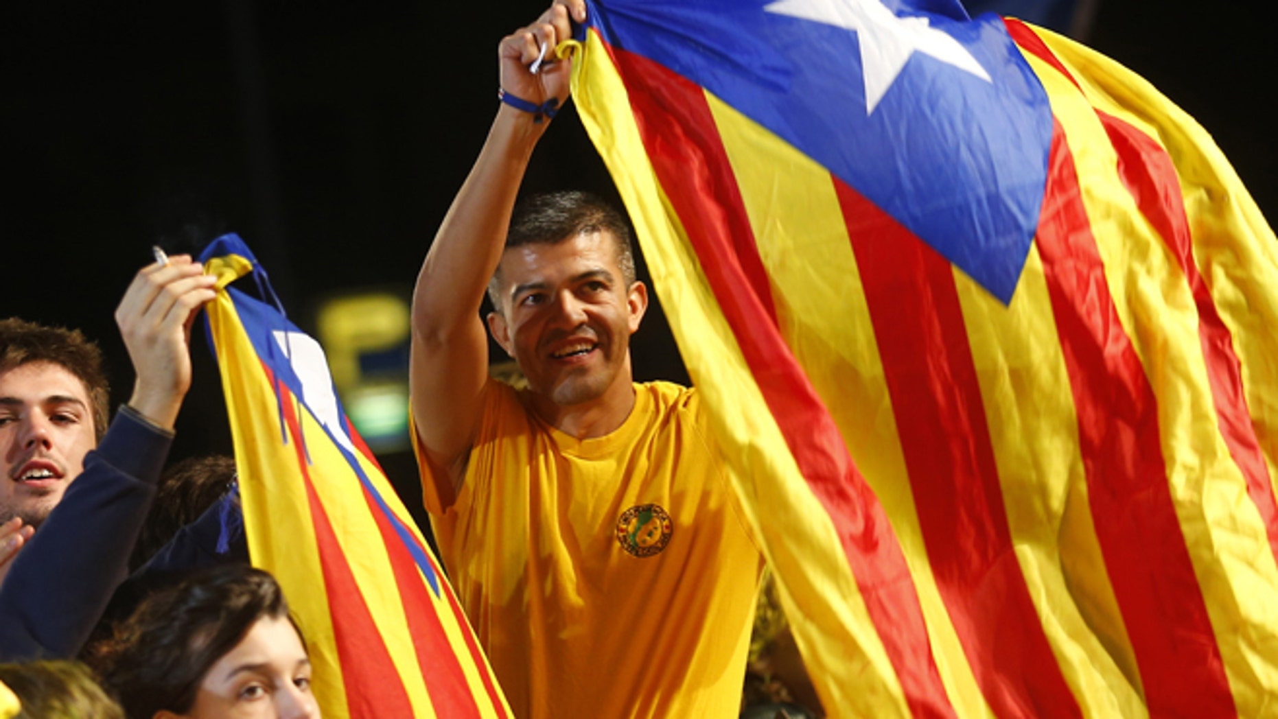 Sept. 27, 2015: Catalonian pro-independence supporters celebrate in Barcelona, Spain.