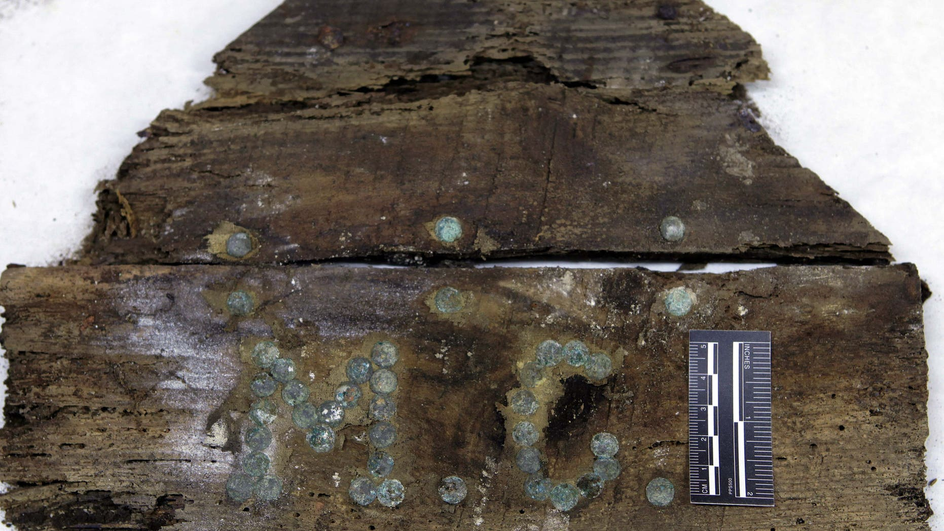 """In this photo taken on Saturday, Jan. 24, 2015 and provided by Aranzadi Science Society, the initials """"M.C"""" are seen on a plank of a coffin found on unidentified graves in the chapelâs crypt of the closed order Convent of the Barefoot Trinitarians in Madrid's historic Barrio de las Letras, or Literary Quarter. Experts searching for the remains of Miguel de Cervantes, the author of  'Don Quixote'  who was buried in 1616 at the Convent but the exact whereabouts of his grave are unknown, have found a casket bearing the initials âM.C.â with bones inside it in crypt underneath a cloistered convent. Archeologists say they made the find over the weekend after excavations to solve the centuries-old mystery of where the great Spanish writer was laid to rest. (AP Photo/Aranzadi Science Society)"""