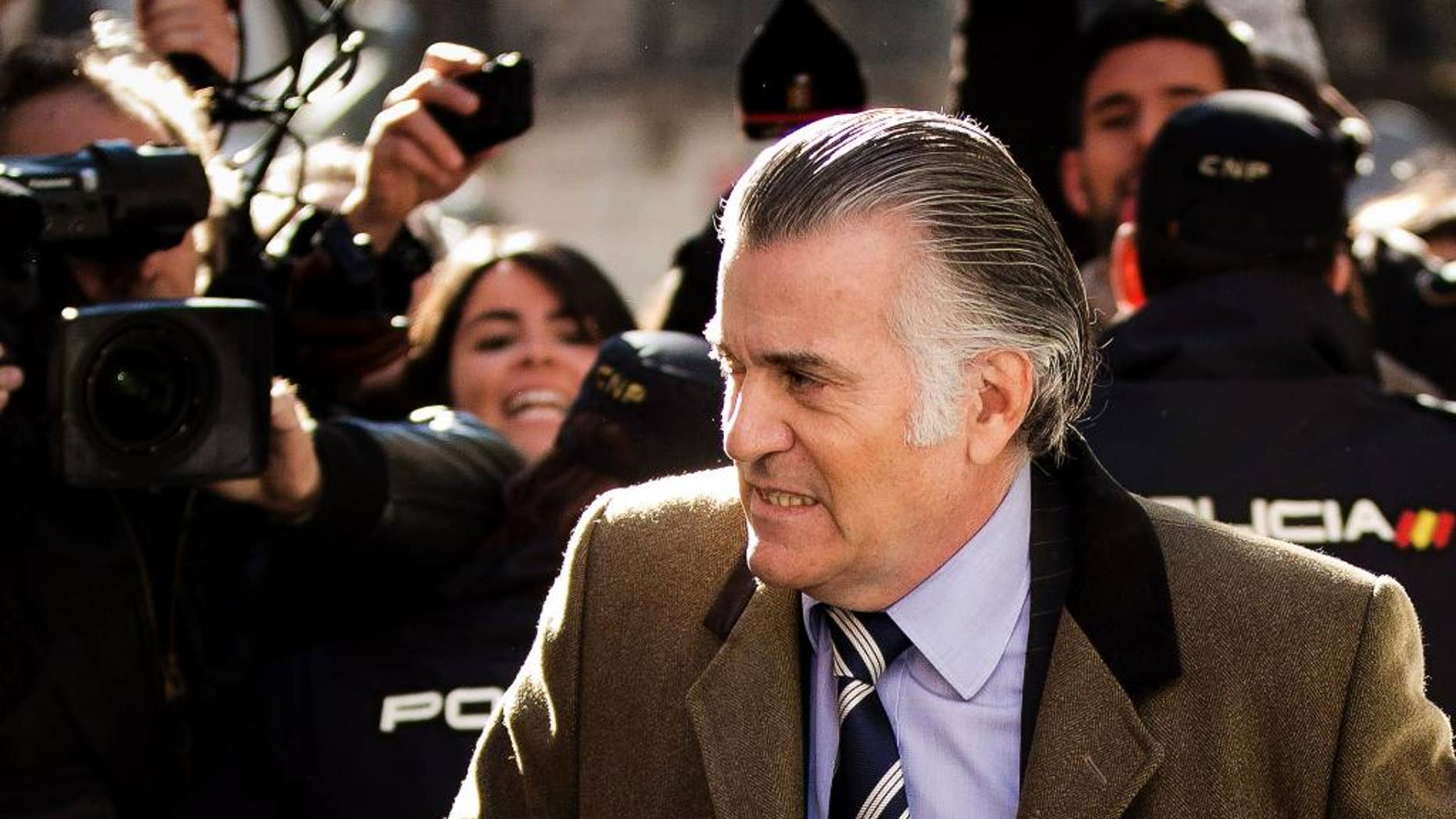 FILE -  In this Feb. 6, 2013 file photo, former Popular Party treasurer Luis Barcenas arrives to the anti-corruption prosecuting office in Madrid. Bail has been set for a former ruling party finance chief jailed since 2013 amid accusations he ran a slush fund that benefited top party officials, including Spanish Prime Minister Mariano Rajoy. A National Court statement said Tuesday, Jan. 20, 2015 that judges set bail for Luis Barcenas at euro 200,000 ($232,000) after previously denying his requests because he had been considered a flight risk. Barcenas has said he made regular payoffs to Popular Party officials including Rajoy. The prime minister and the party deny his claims. (AP Photo/Daniel Ochoa de Olza, File)
