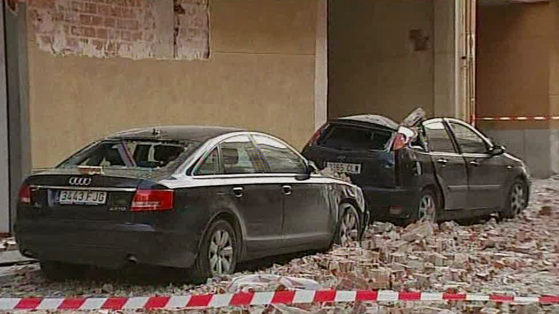 May 11: Damaged vehicles and debris are seen on the street after an earthquake in Lorca Spain in  this image taken from TV.  Two earthquakes struck southeast Spain in quick succession Wednesday, killing several people, and injuring dozens and causing major damage to buildings, officials said. The epicenter of the quakes with magnitudes of 4.4 and 5.2  was close to the town of Lorca, and the second came about two hours after the first. (AP)
