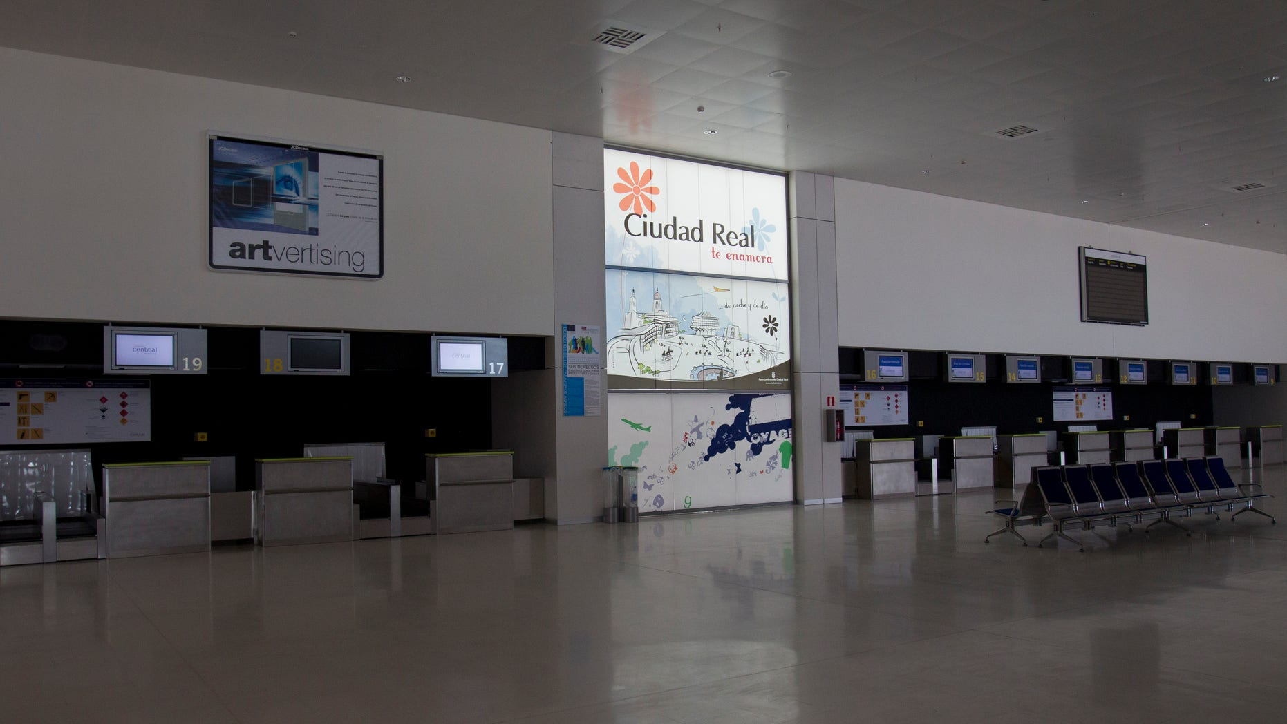 Check-in desks stand empty at the Central airport in Ciudad Real, Spain.