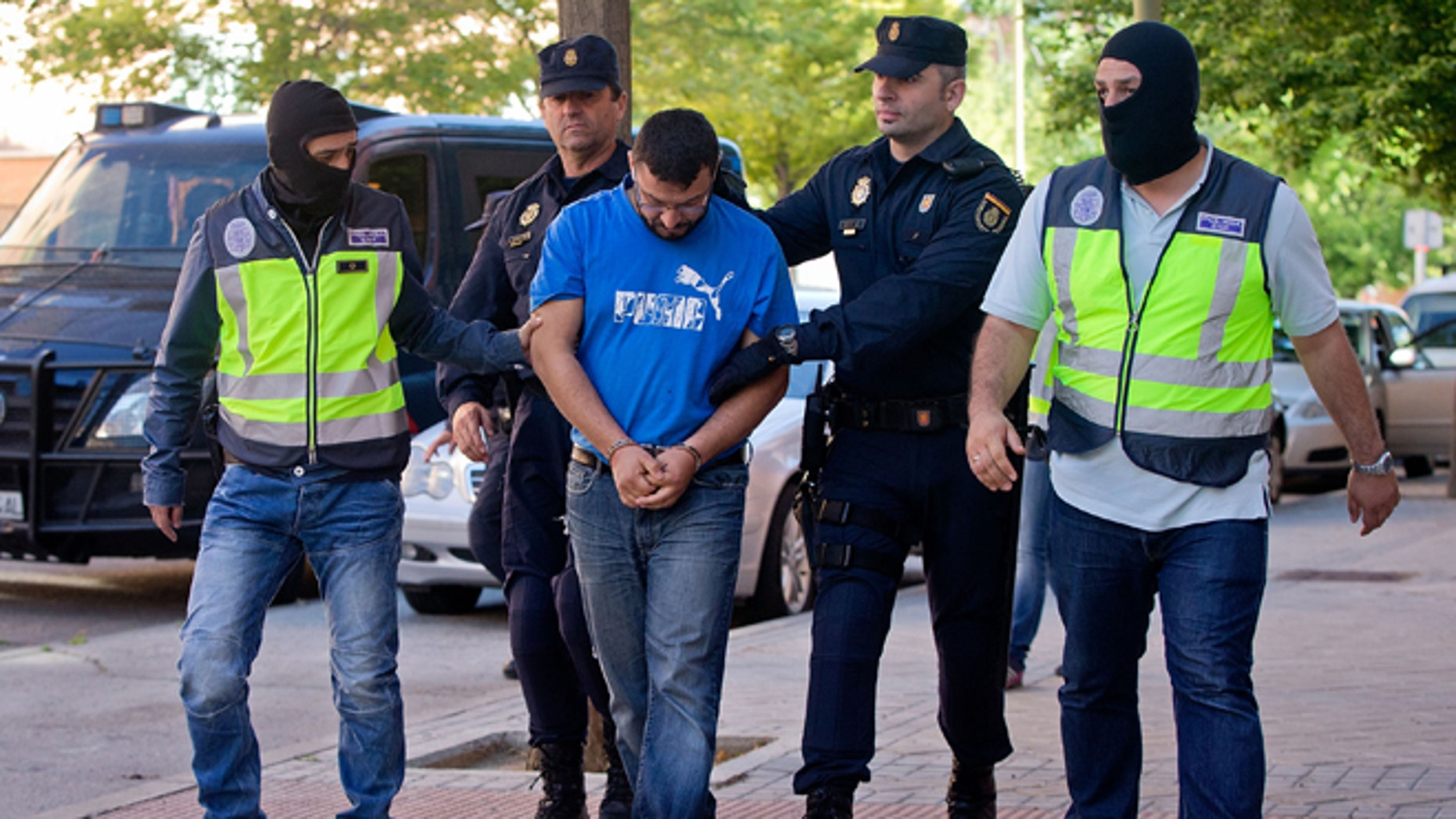 Police arrest a man suspected of belonging to a Jihadist recruiting network on June 16, 2014 in Madrid, Spain.