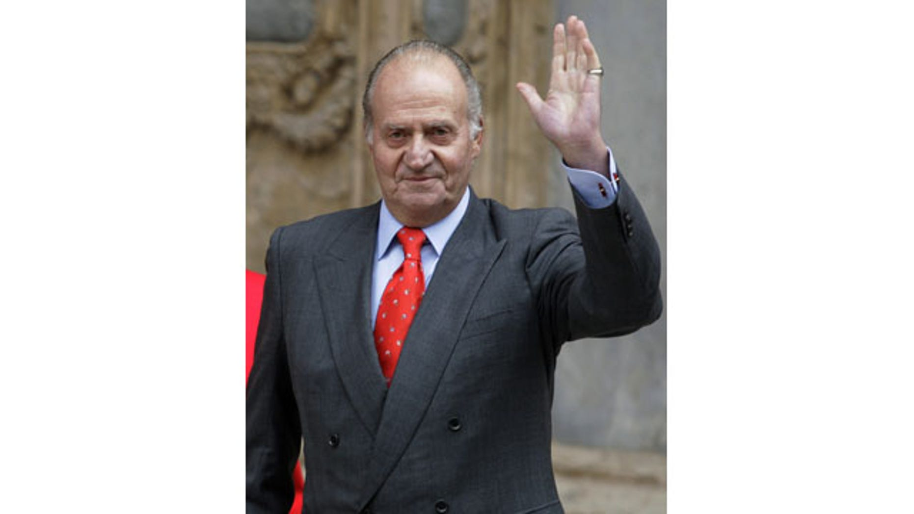 FILE - In this file photo from April 12, 2009, Spanish King Juan Carlos, waves after attending an Easter Mass at the Cathedral of Palma de Mallorca, Spain. (AP)