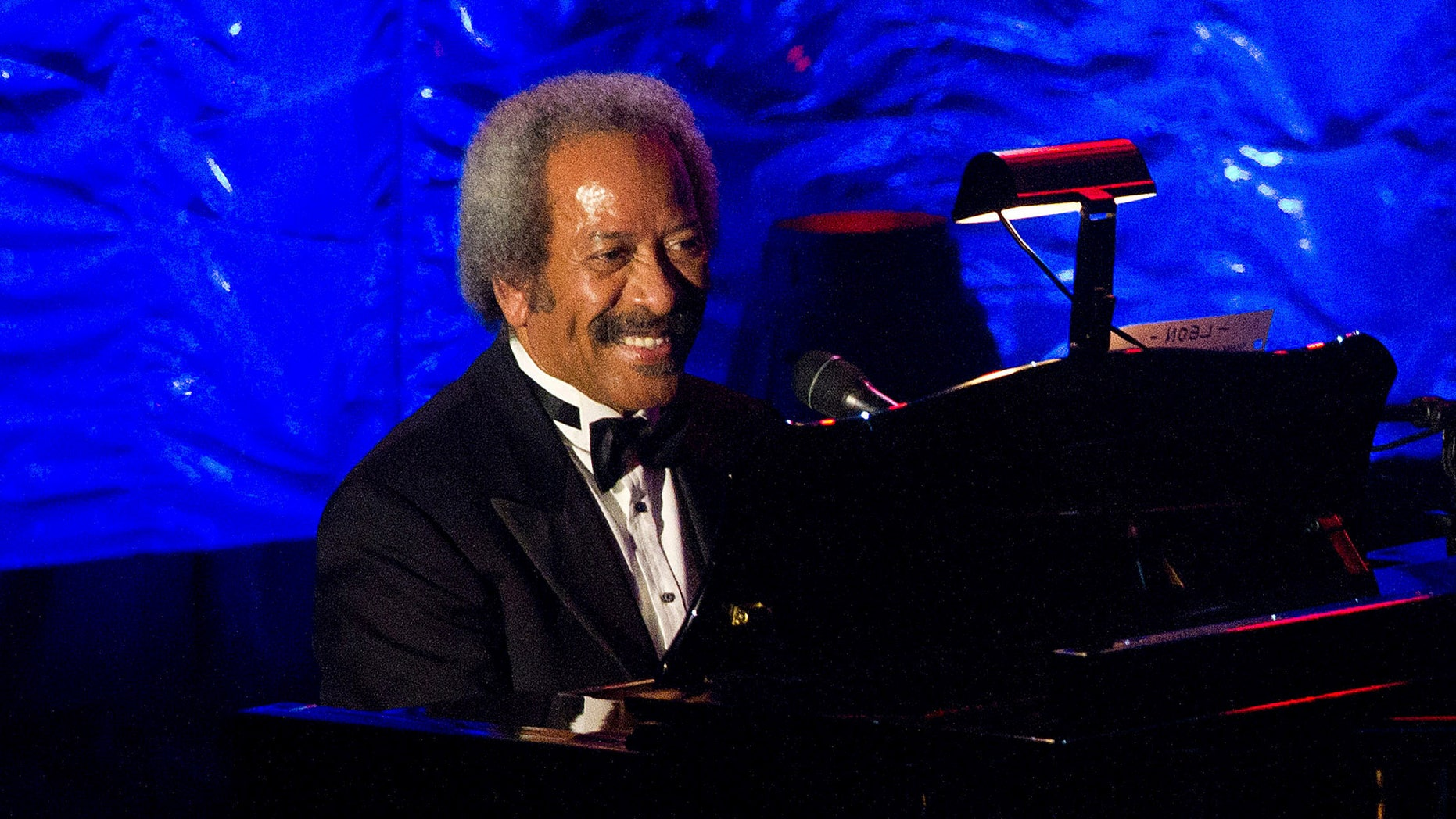 FILE - In this June 16, 2011 file photo, Allen Toussaint performs onstage at the 42nd Annual Songwriters Hall of Fame Awards in New York. Legendary New Orleans musician and composer Allen Toussaint has died after suffering a heart attack following a concert he performed in the Spanish capital. Madrid emergency services spokesman Javier Ayuso says rescue workers were called to Toussaint's hotel early Monday Nov. 9, 2015 and managed to revive him after he suffered a heart attack but he stopped breathing during the ambulance ride to a hospital and efforts to revive him again were unsuccessful. Toussaint performed Sunday night at Madrid's Lara Theater. (AP Photo/Charles Sykes, File)