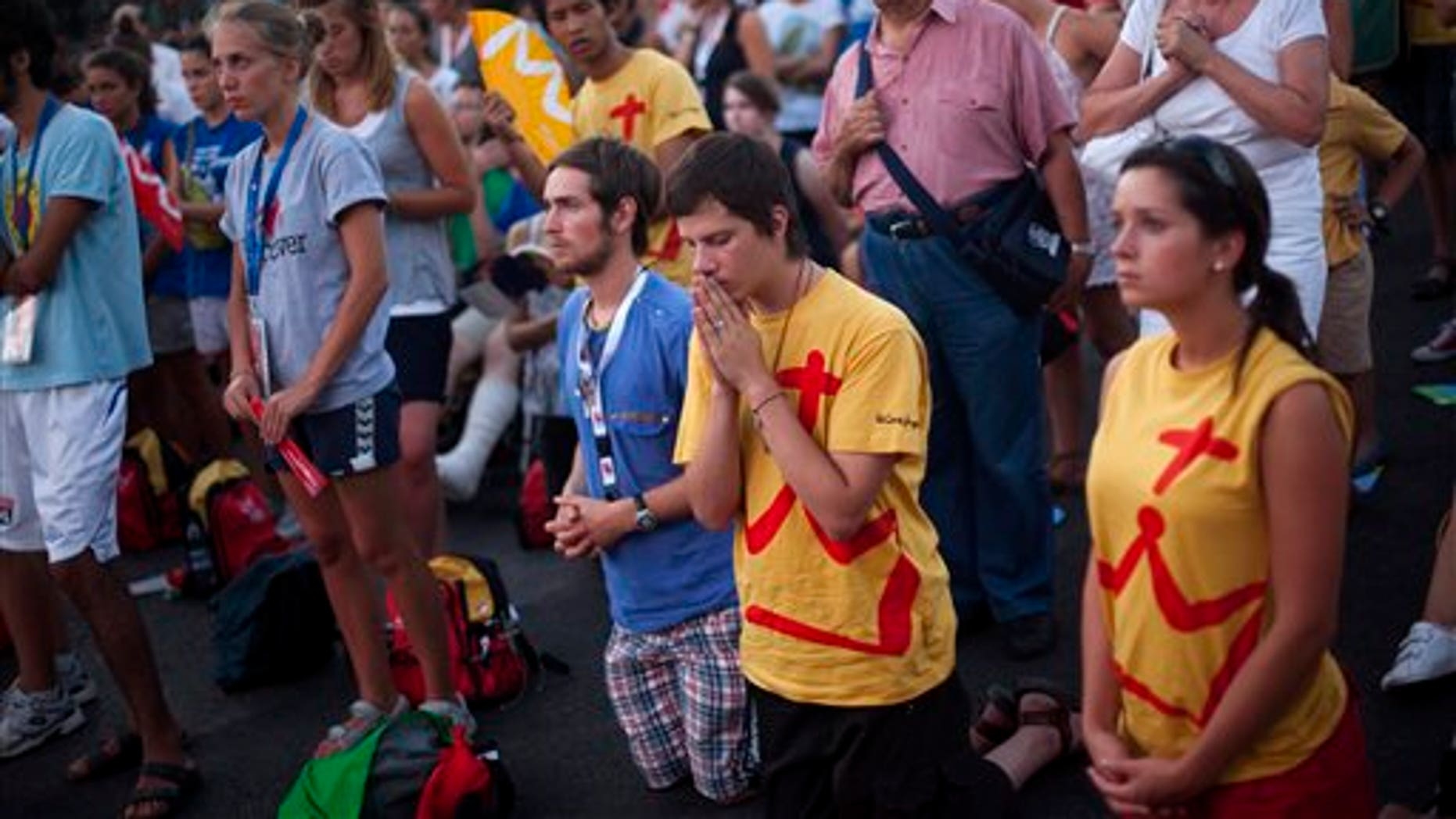 Aug. 16: Pilgrims pray at the street during a mass at the Cibeles square, ahead to the visit of Pope Benedict XVI in Madrid next Aug. 18- 21.