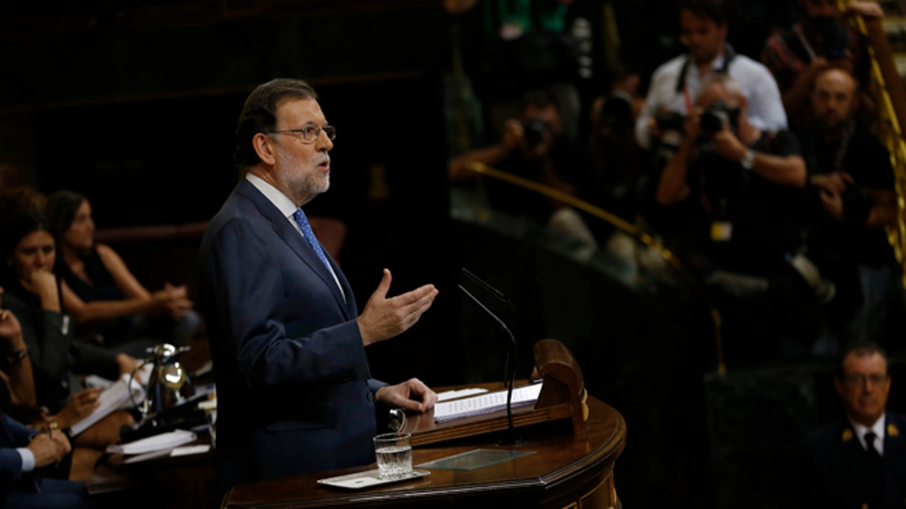 Spain's acting Prime Minister and Popular Party leader Mariano Rajoy addresses lawmakers during the first of the two-day investiture debate at the Spanish parliament in Madrid, Tuesday, Aug. 30, 2016. Rajoy is to start a two-day parliamentary debate later Tuesday ahead of a vote on his bid to form a minority government and end an eight-month political impasse, but the signs are he won't be successful. (AP Photo/Francisco Seco)
