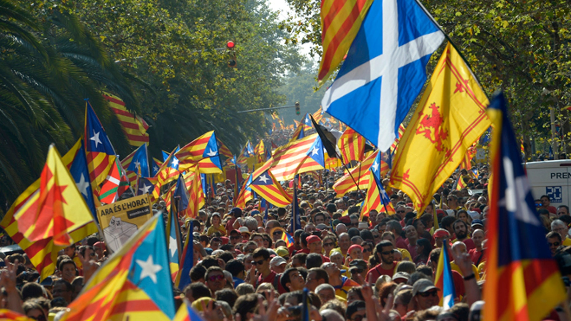 A Saltire flag, top right, is seen amongst estelada flags, symbolizing Catalonia's independence, during a demonstration calling for the independence of Catalonia in Barcelona, Spain, Thursday, Sept 11, 2014. A week before Scotland votes on whether to break away from the United Kingdom, separatists in northeastern Spain were trying to convince hundreds of thousands to protest across Catalonia to demand a secession sentiment vote that the central government in Madrid insists would be illegal. AP Photo/Manu Fernandez)