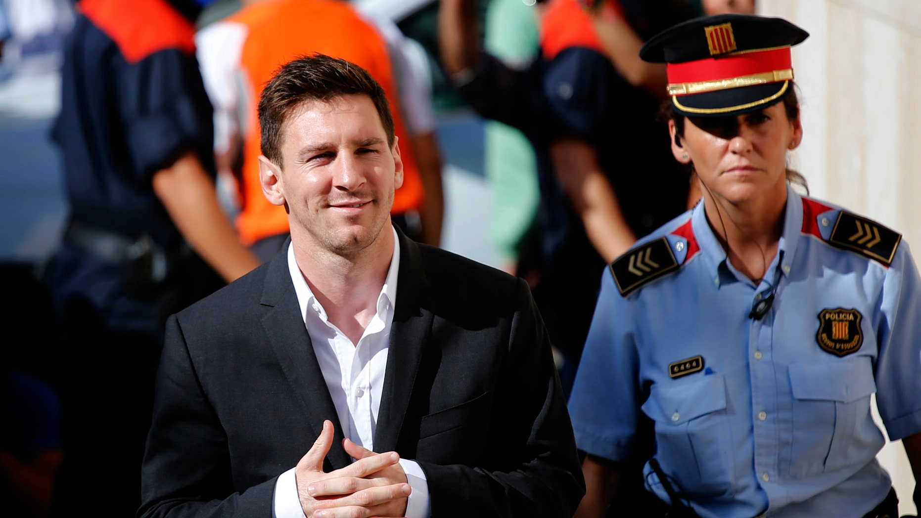 FILE - In this Sept. 27, 2013 file photo, FC Barcelona star Lionel Messi, left, arrives at a court to answer questions in a tax fraud case in Gava, near Barcelona, Spain. Spanish court officials say Lionel Messi's tax fraud trial has been set for May 31-June 3, 2016. Messi and his father, Jorge Horacio Messi, have been charged with three counts of tax fraud and could be sentenced to nearly two years in prison if found guilty. They are accused of defrauding Spain's tax office of 4.1 million euros ($4.4 million) in unpaid taxes from 2007-09. (AP Photo/Emilio Morenatti, File)