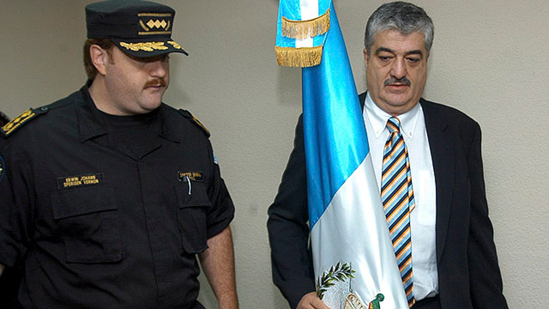 Photo taken on November 12, 2005 showing the then Interior Minister of Guatemala Carlos Vielman, right, with  Guatemala Chief of Police Edwin Sperinsen. Spanish police say they have arrested former Guatemalan Interior Minister Carlos Vielman wanted in connection with the alleged killing of seven prisoners in 2006.