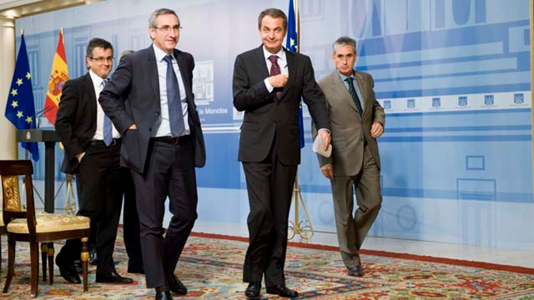 Spain's Prime Minister Jose Luis Rodriguez Zapatero, center, leaves after a press conference at the Moncloa Palace, in Madrid, Monday Sept. 26, 2011. Spain's prime minister dissolved Parliament on Monday, setting the stage for a Nov. 20 general election that is likely to focus on an economy saddled with 21 percent unemployment, anemic growth and gloomy future prospects.   (AP Photo/Daniel Ochoa de Olza)