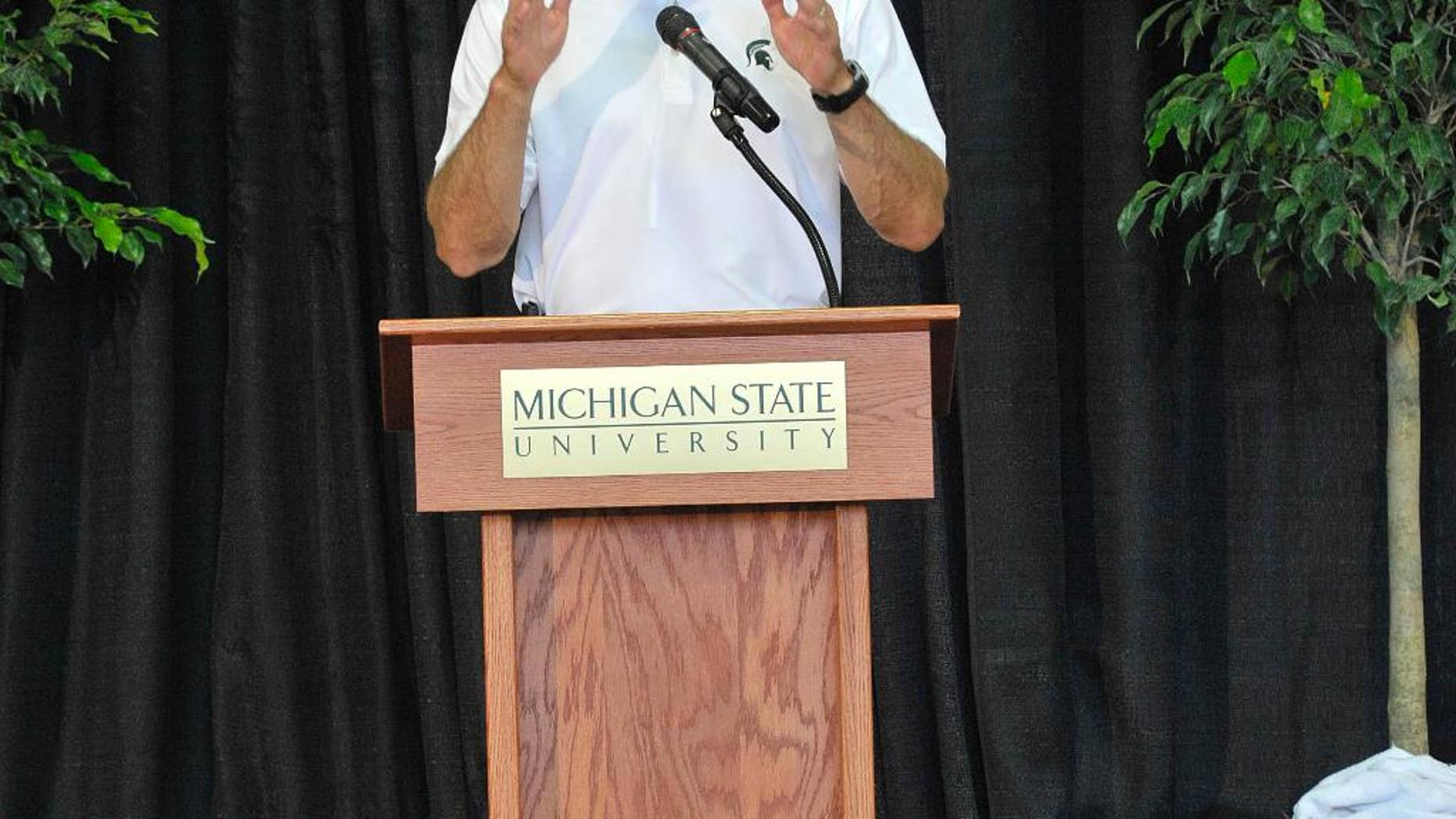In this photo taken on Monday, Aug. 25, 2014, Michigan State head football coach Mark Dantonio speaks during a ceremony as the university unveils their north end zone addition to Spartan Stadium in East Lansing, Mich. (AP Photo/Detroit News,  Dale G. Young)  DETROIT FREE PRESS OUT; HUFFINGTON POST OUT