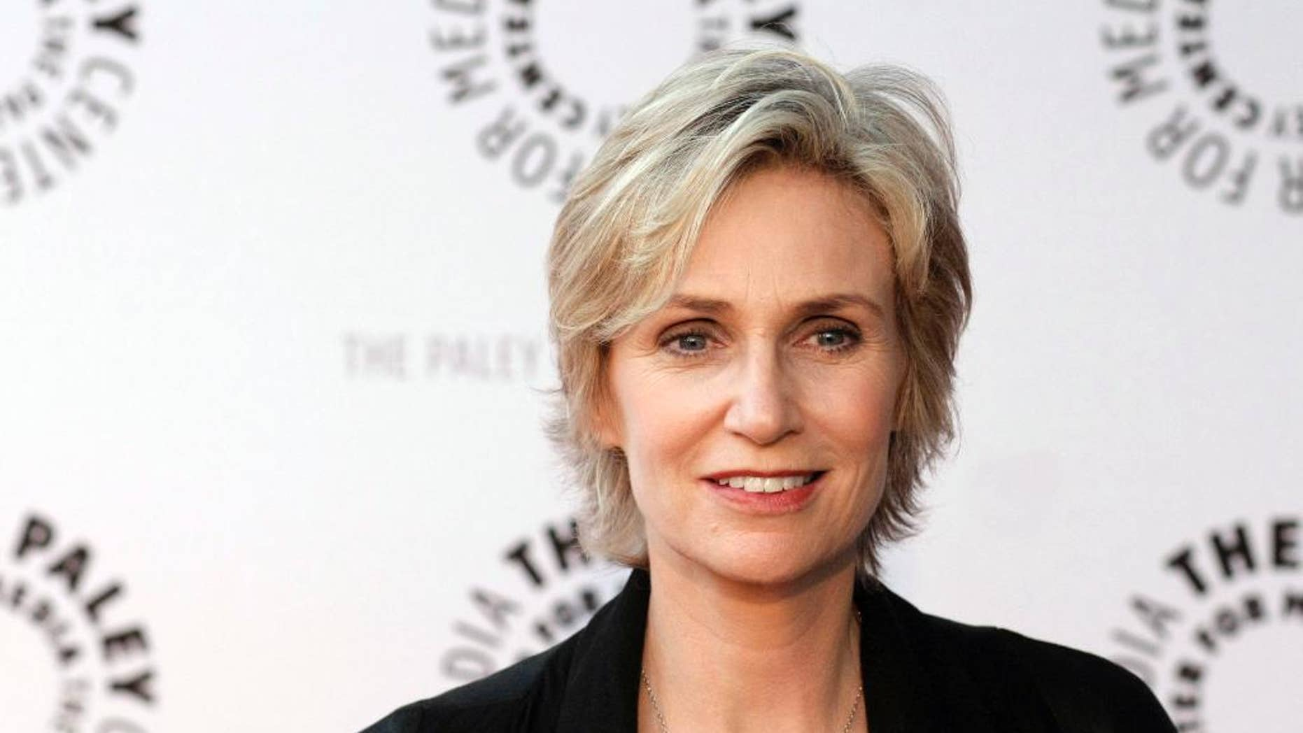 """FILE - In this March 13, 2010, file photo, actress Jane Lynch arrives at the """"Glee"""" PaleyFest panel discussion in Beverly Hills, Calif. Lynch will attend the opening ceremony of the Special Olympics USA Games on Sunday. (AP Photo/Dan Steinberg, File)"""