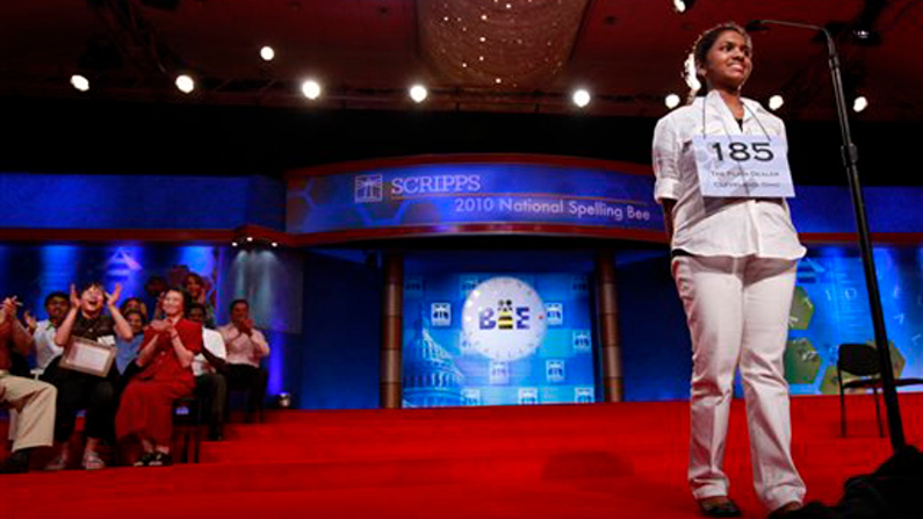 """June 4, 2010: Anamika Veeramani, 14, of North Royalton, Ohio, smiles as she wins the 2010 National Spelling Bee with the word """"stromuhr"""" in Washington."""